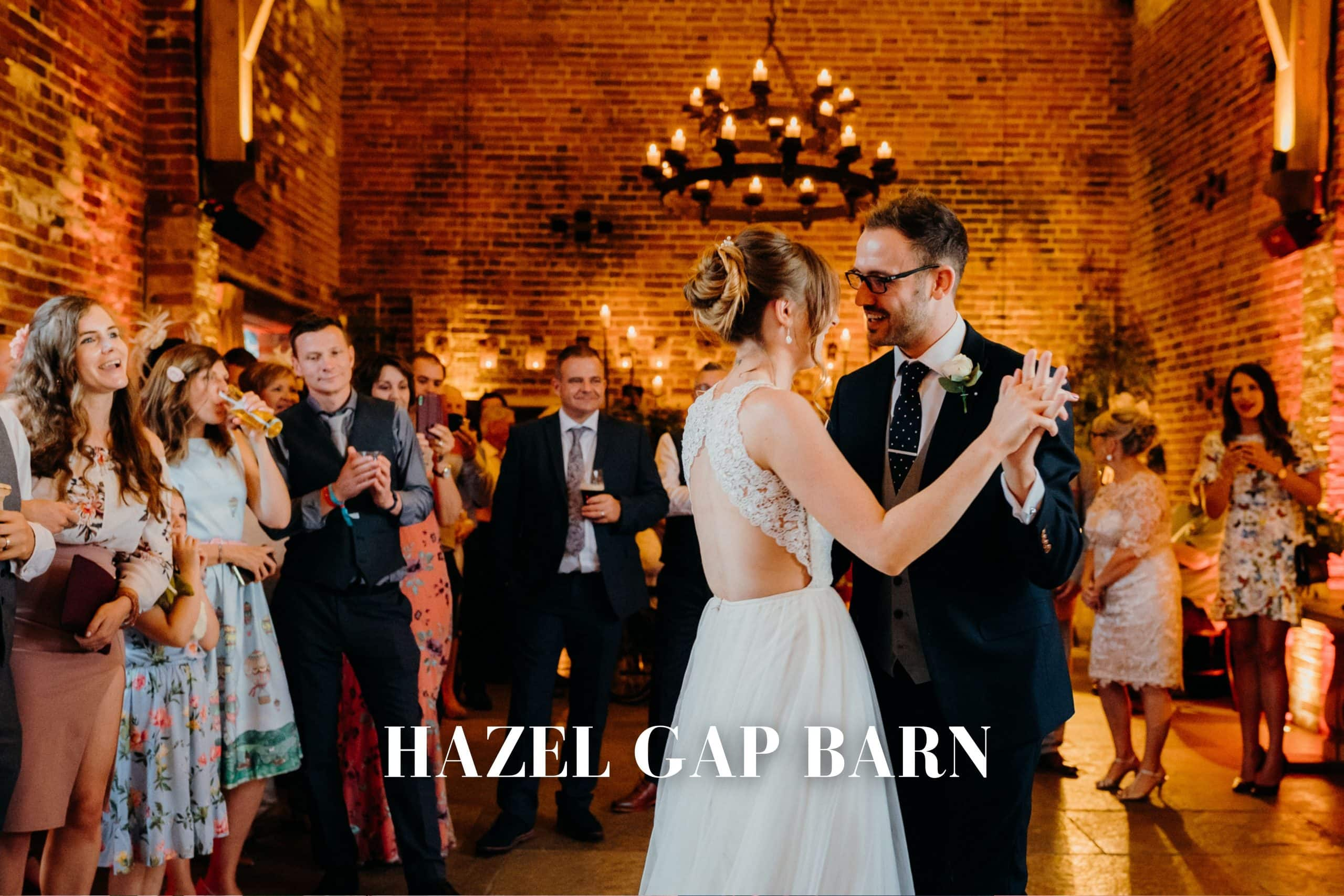Wedding photography At Hazel Gap Barn - bride and groom enjoy the first dance with their family and friends