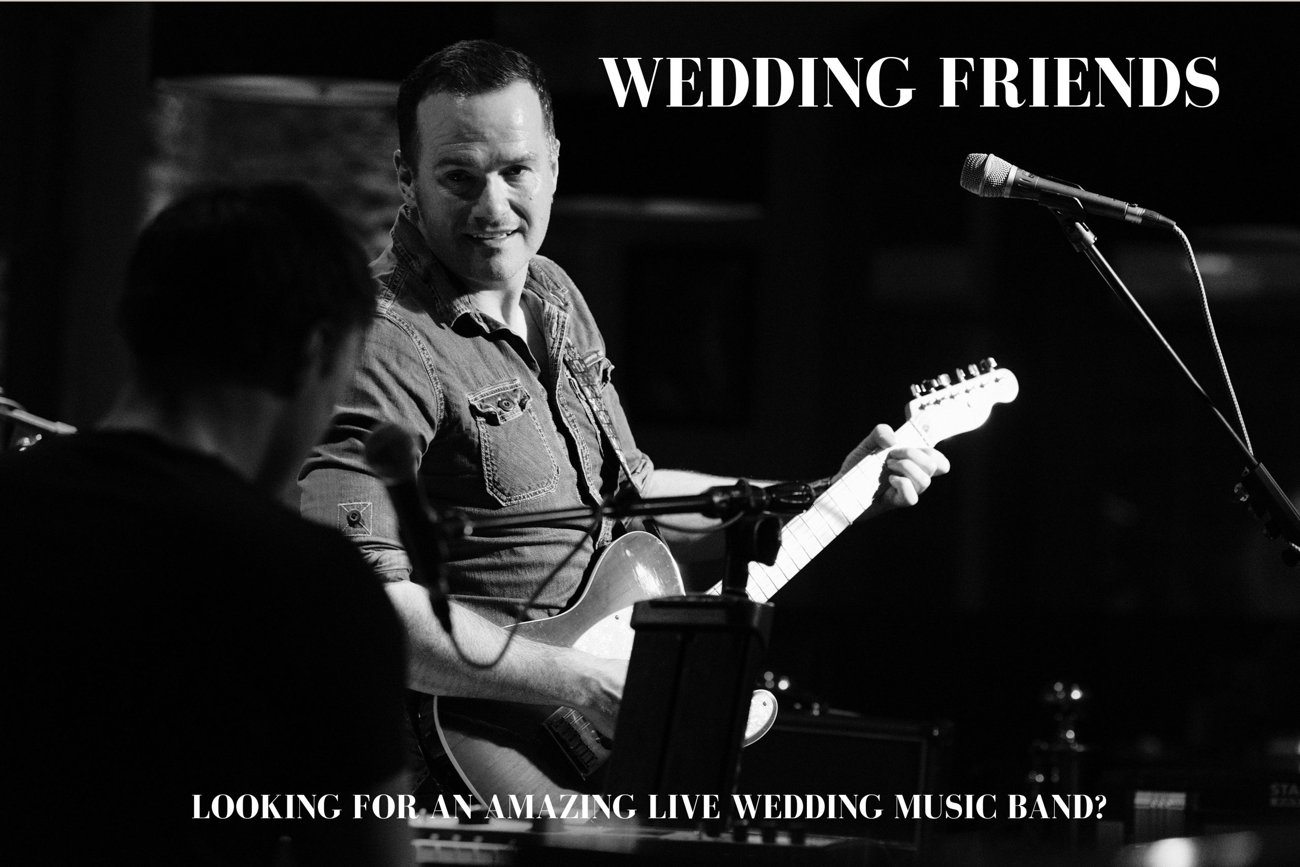 Nottingham Live Wedding Music Band - Lead Singer playing guitar and singing