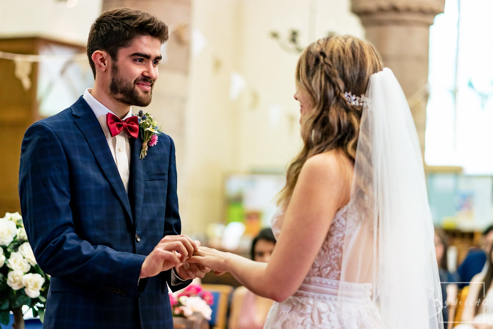 Emotional groom and bride exchange rings at their church wedding in Herefordshire