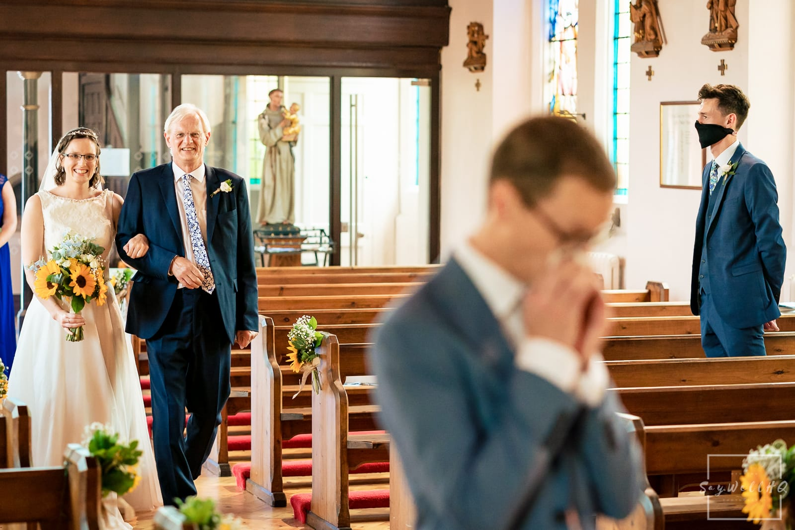 Bride and her Father walking down the aisle arm in arm