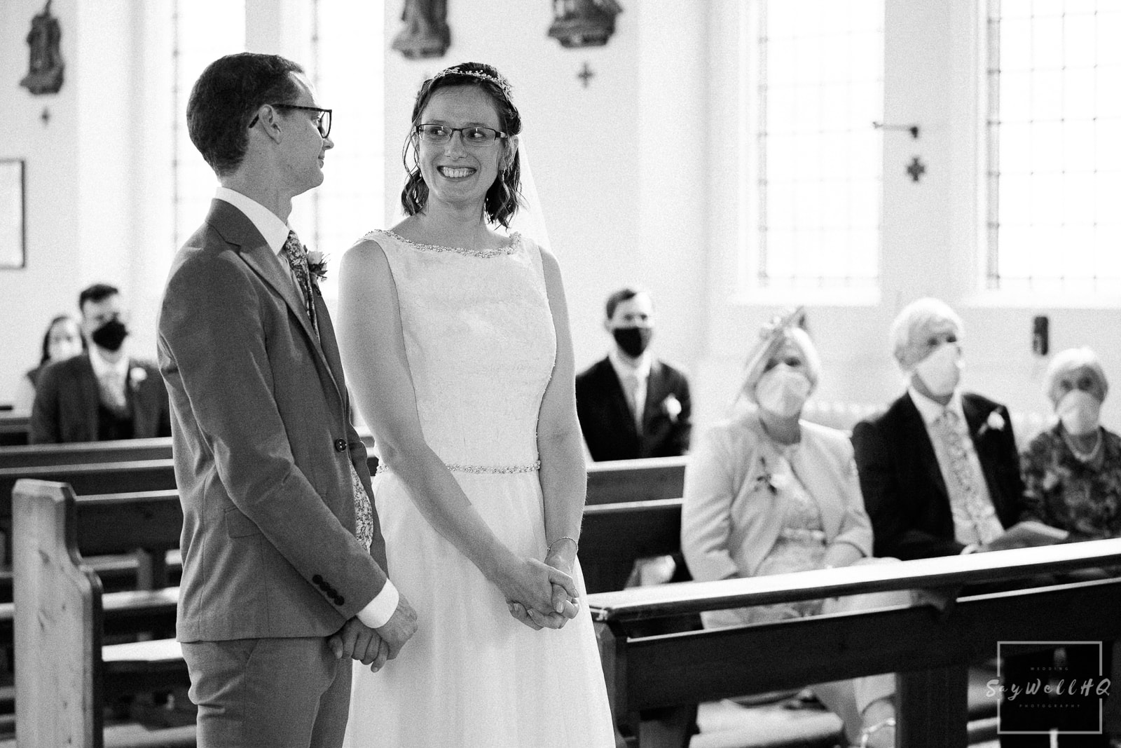 Bride and groom looking lovingly at each other during their wedding ceremony in Melbourne Derbyshire