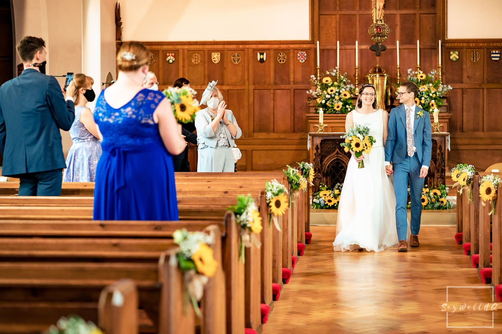 bride and groom walking down the aisle after getting married in a church wedding in Melbourne in Derbyshire