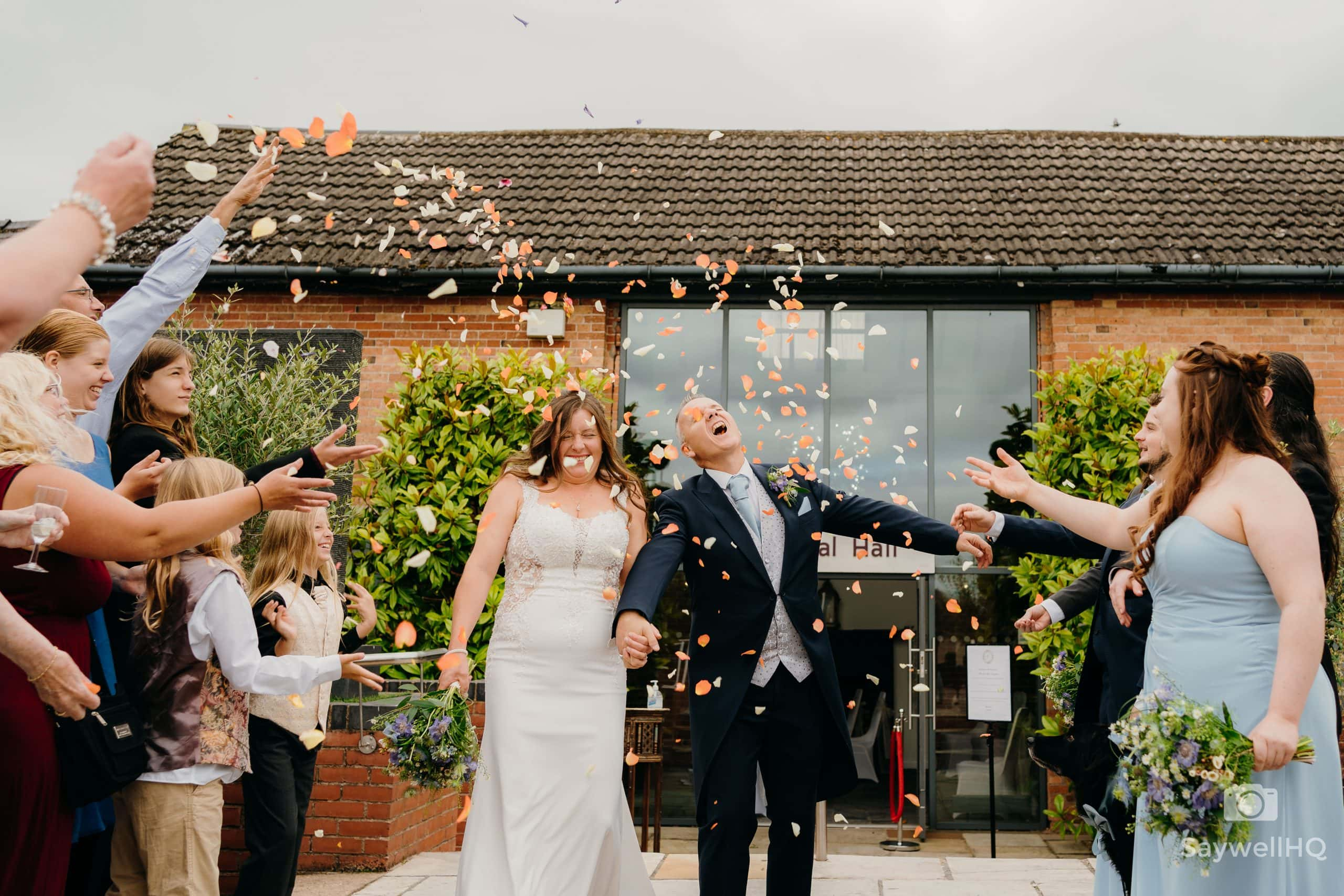bride and groom get covered in confetti in the grounds of Goosedale nottingham during the COVID 19 wedding restrictions