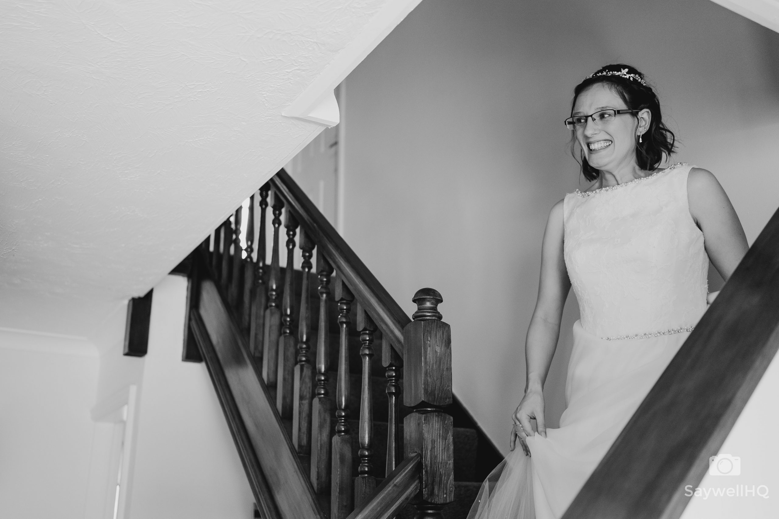 bride looking excited at putting her wedding dress on during the Covid wedding restrictions