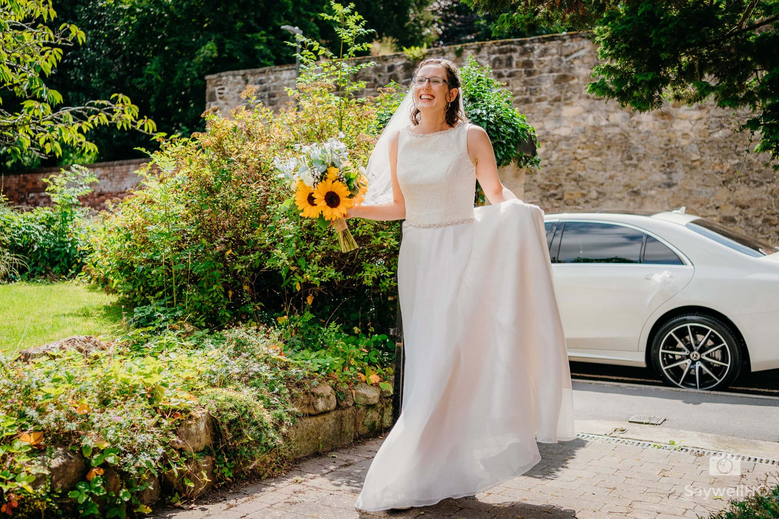 the bride arrives at her COVID Church wedding in Derbyshire