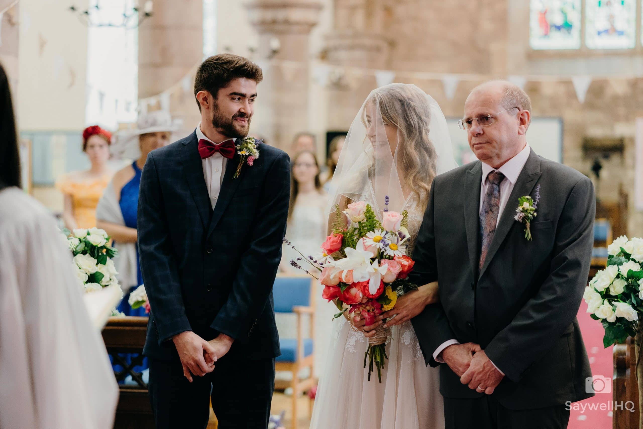 Bride and Groom share a loving glance at their COVID impacted wedding