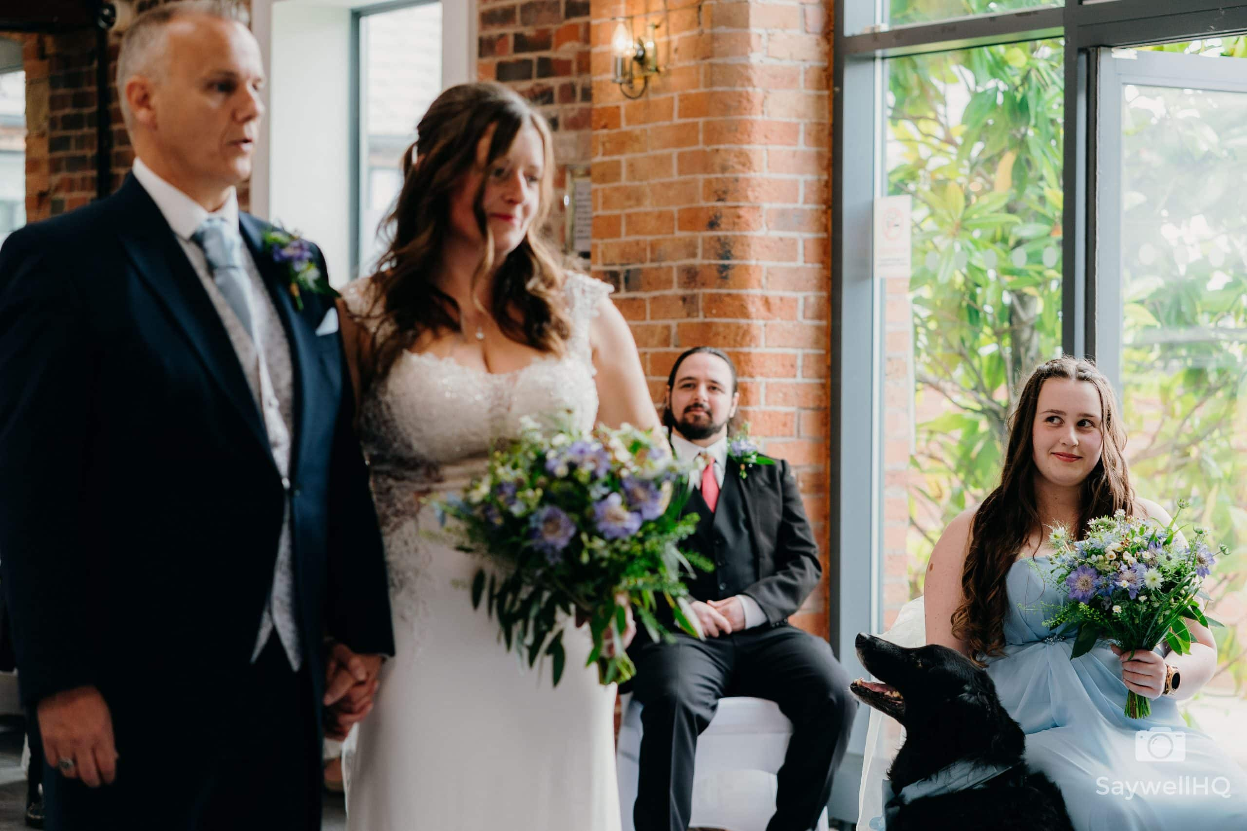daughter of the bride looking on as her mum gets married at Goosedale in Nottingham during a COVID wedding