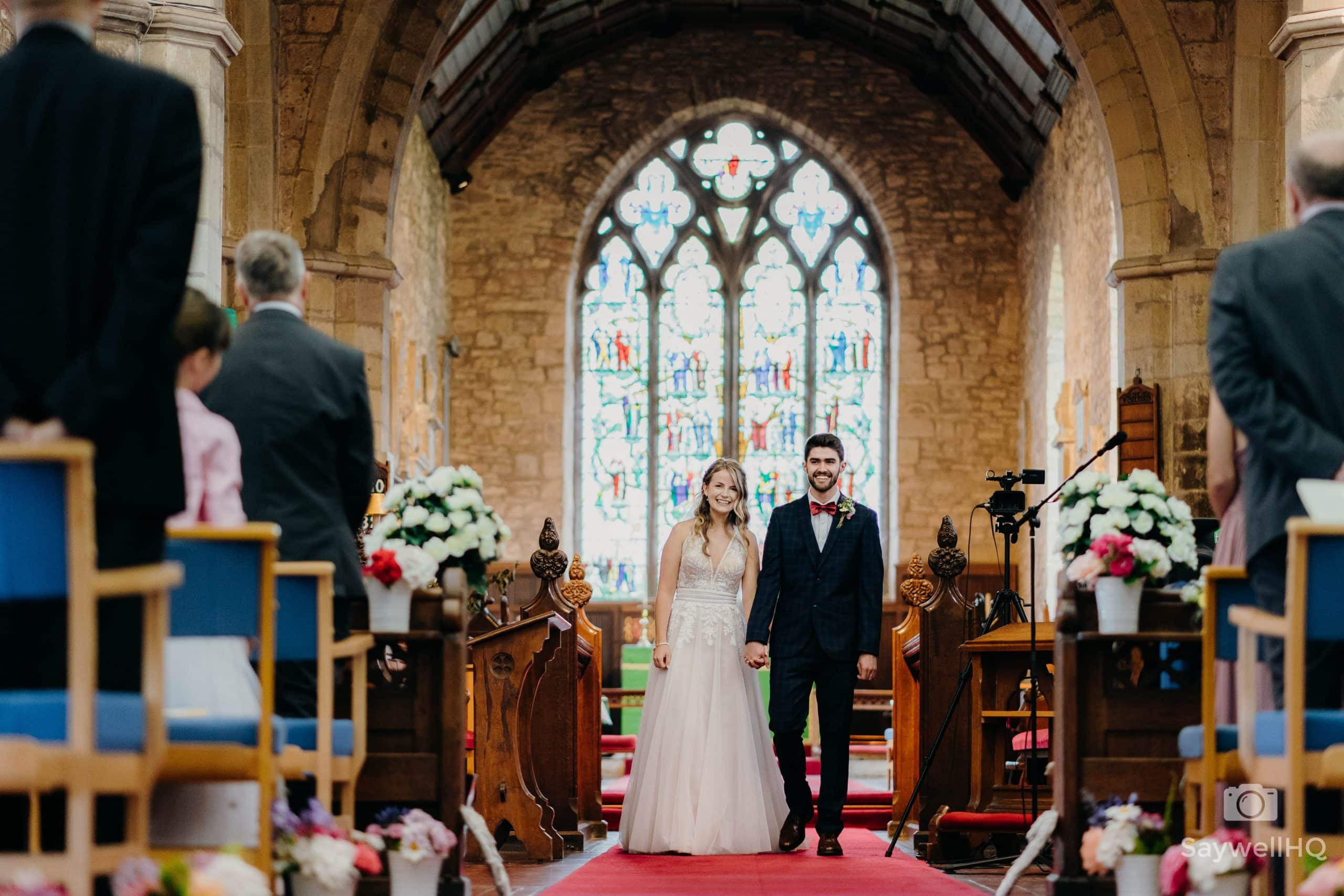 bride and groom walking down the aisle after getting married in a church wedding in Bromyard Herefordshire