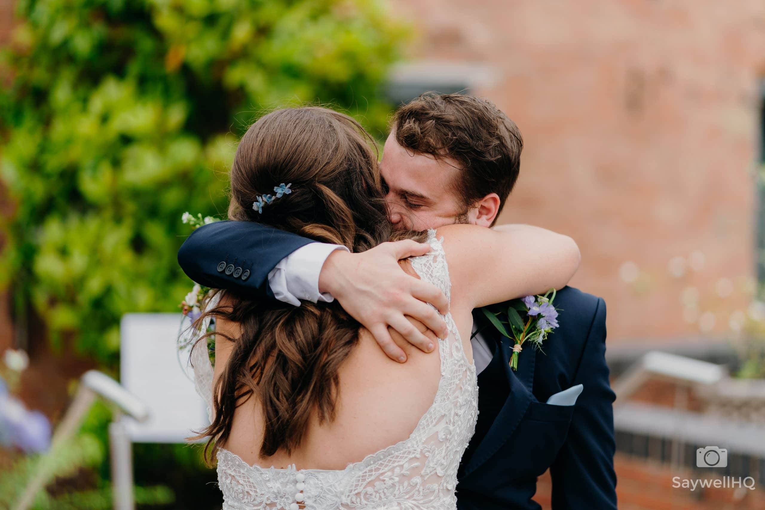 bride and her son hug after the wedding ceremony at Goosedale during the COVID wedding restrictions