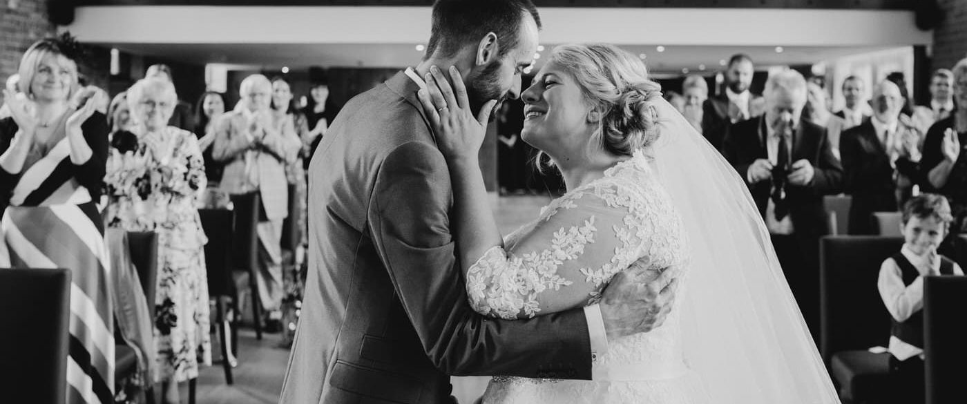 bride and groom first kiss during their nottingham wedding