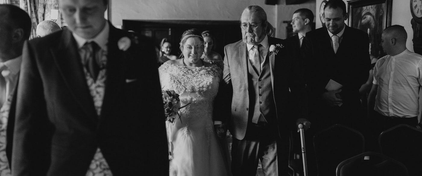 bride and her father walking down the short wedding aisle