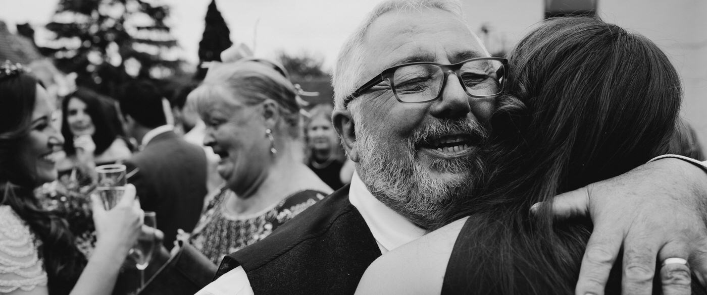 big bear hug from the father of the bride after his daughters humanist wedding