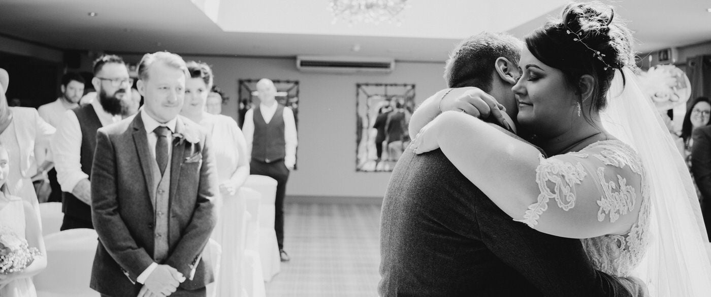 bride and groom hug at the end of their wedding ceremony at the peak edge hotel
