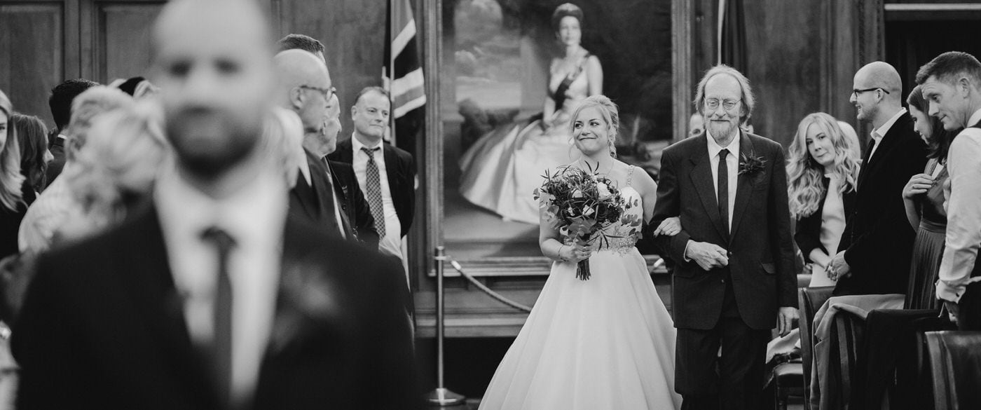 bride and her father walking down the aisle in the nottingham council house