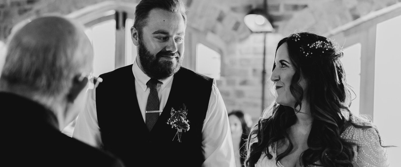 bride and groom looking lovingly at each other during their humanist wedding ceremony