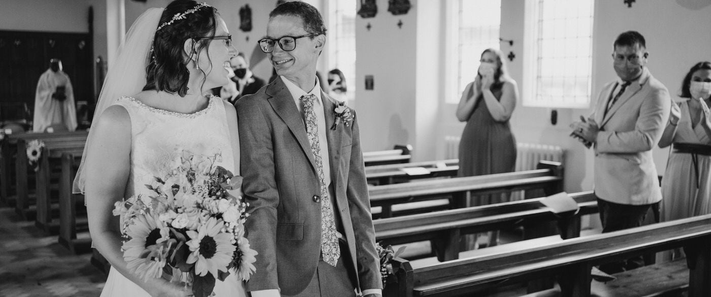 melbourne derby wedding photographer - bride and groom walking down the church aisle after their wedding