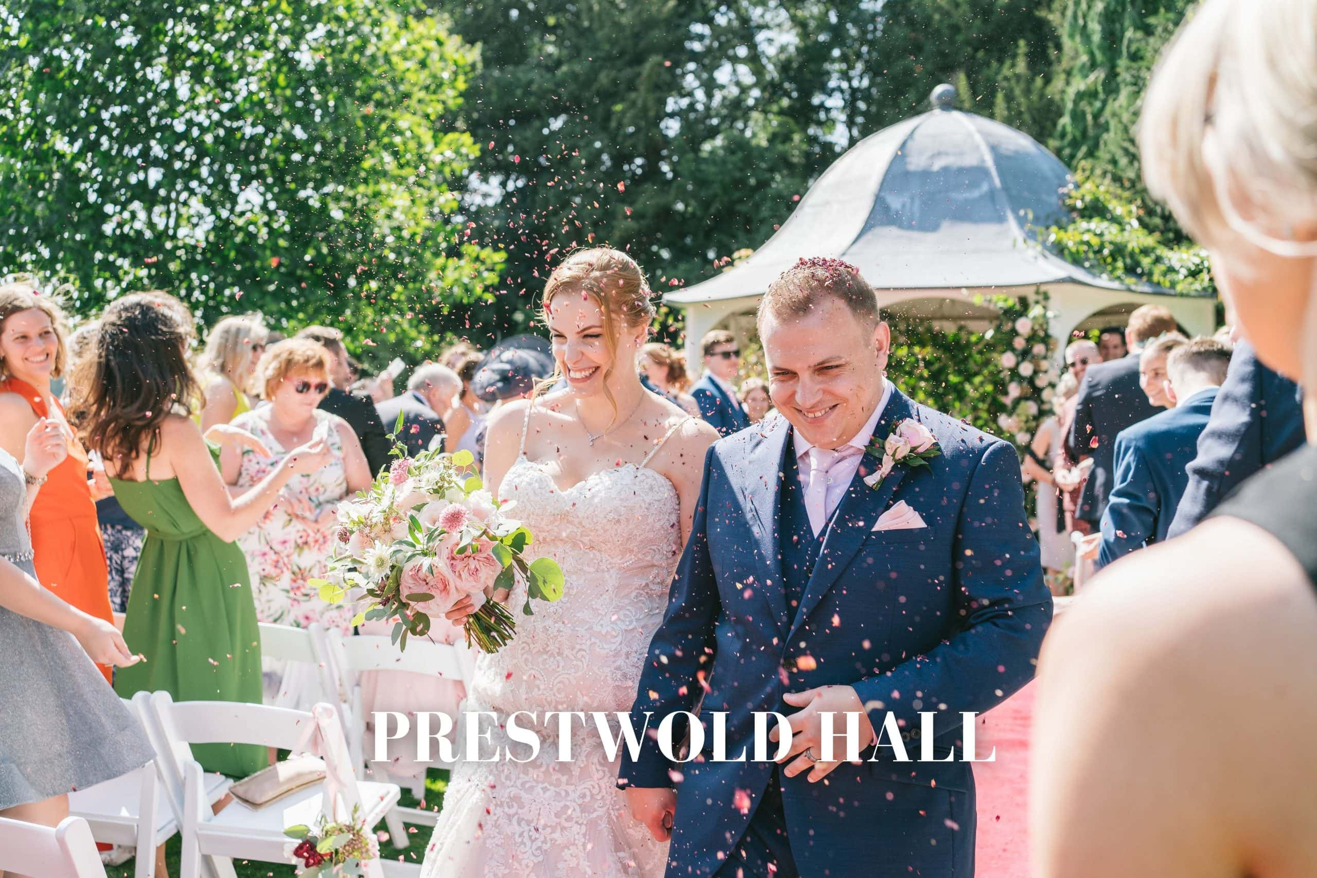 Wedding photography Prestwold Hall - bride and groom confetti outside in the grounds of prestwold hall