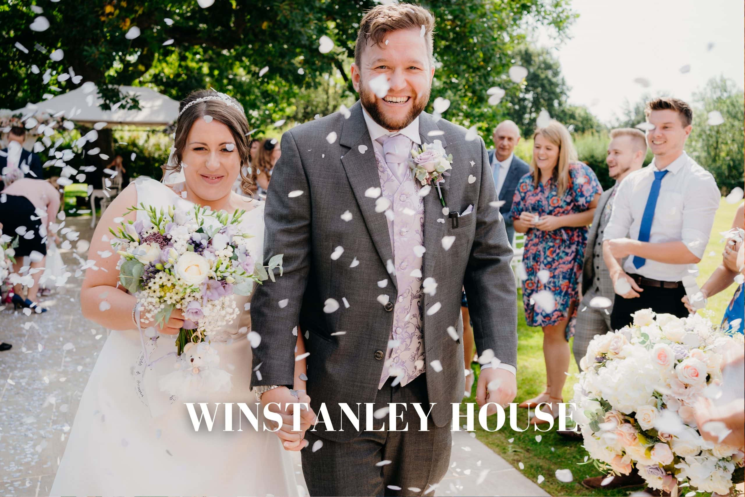 Winstanley House wedding - bride and groom get covered in confetti outside after their outdoor wedding