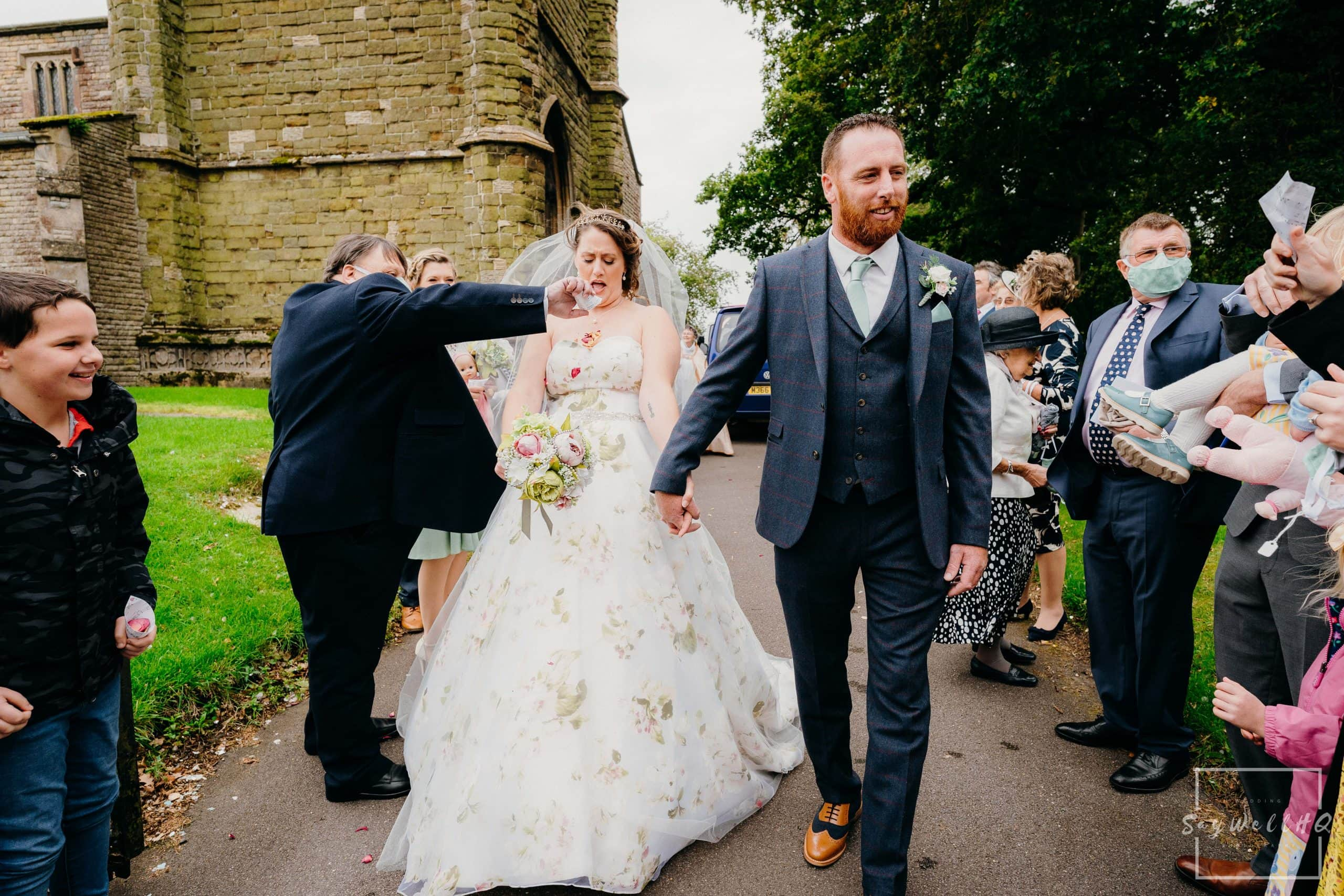 Lincoln wedding photographer - bride and groom get covered in confetti following their wedding in Spilsby in Lincolnshire