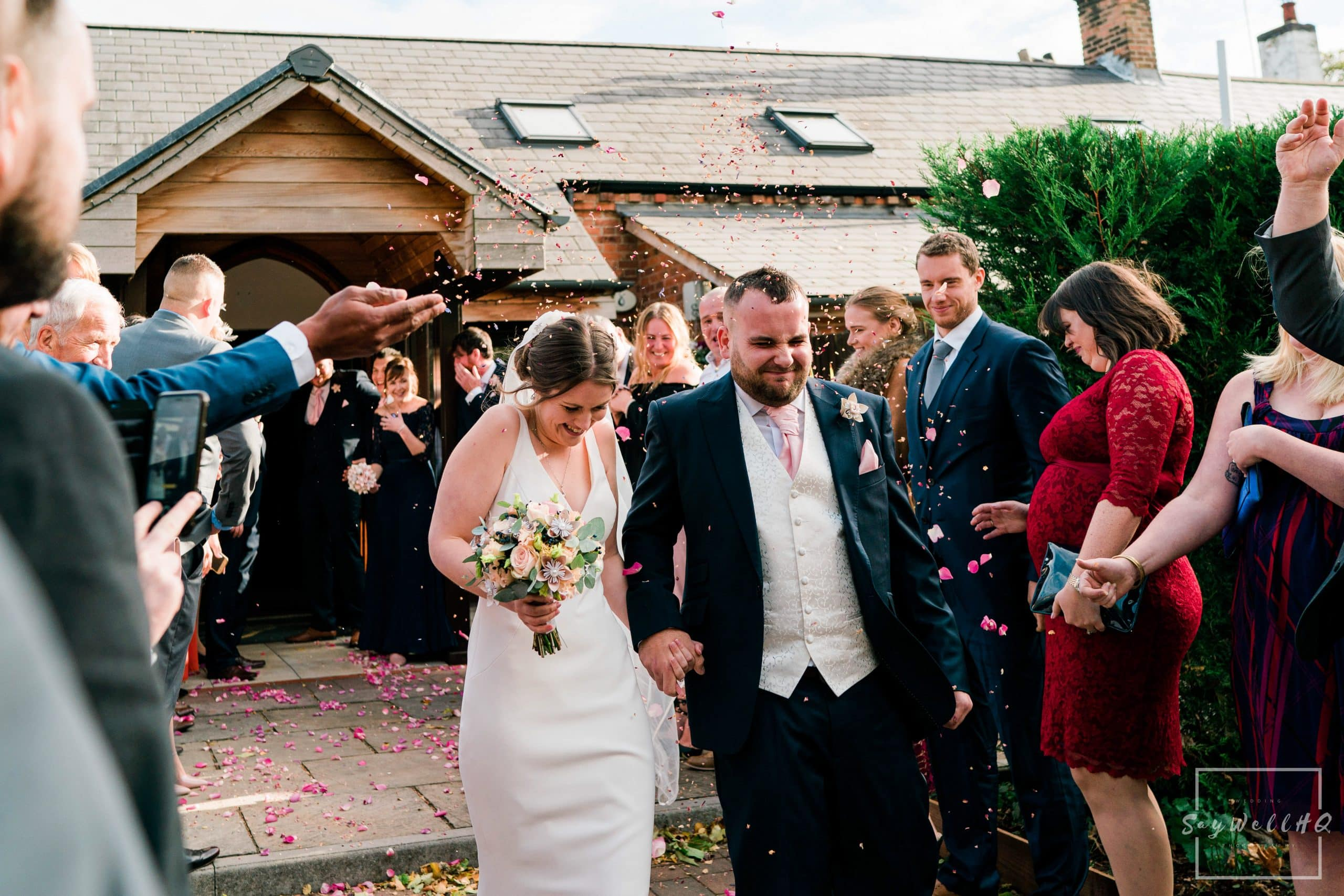 Bride and Groom run through the confetti at their Goosedale wedding - Wedding Photography by goosedale wedding photographer Andy Saywell of SaywellHQ