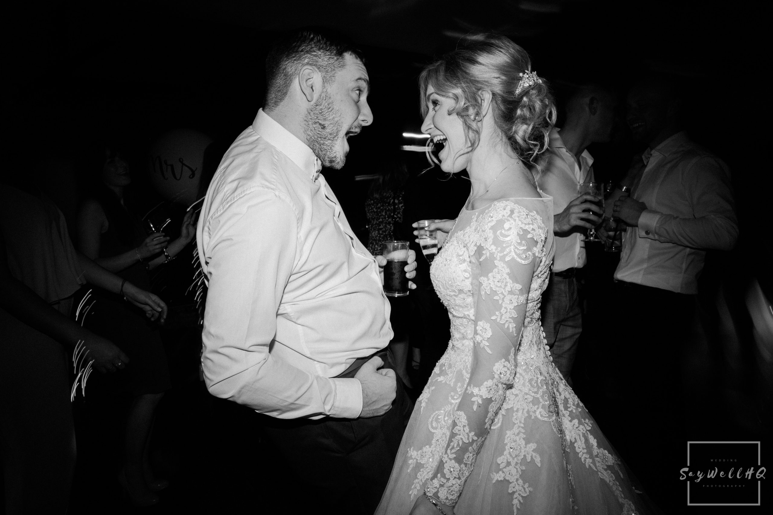 Bride and a wedding guest having fun on the dancefloor during the disco at a Goosedale wedding - Wedding Photography by goosedale wedding photographer Andy Saywell of SaywellHQ