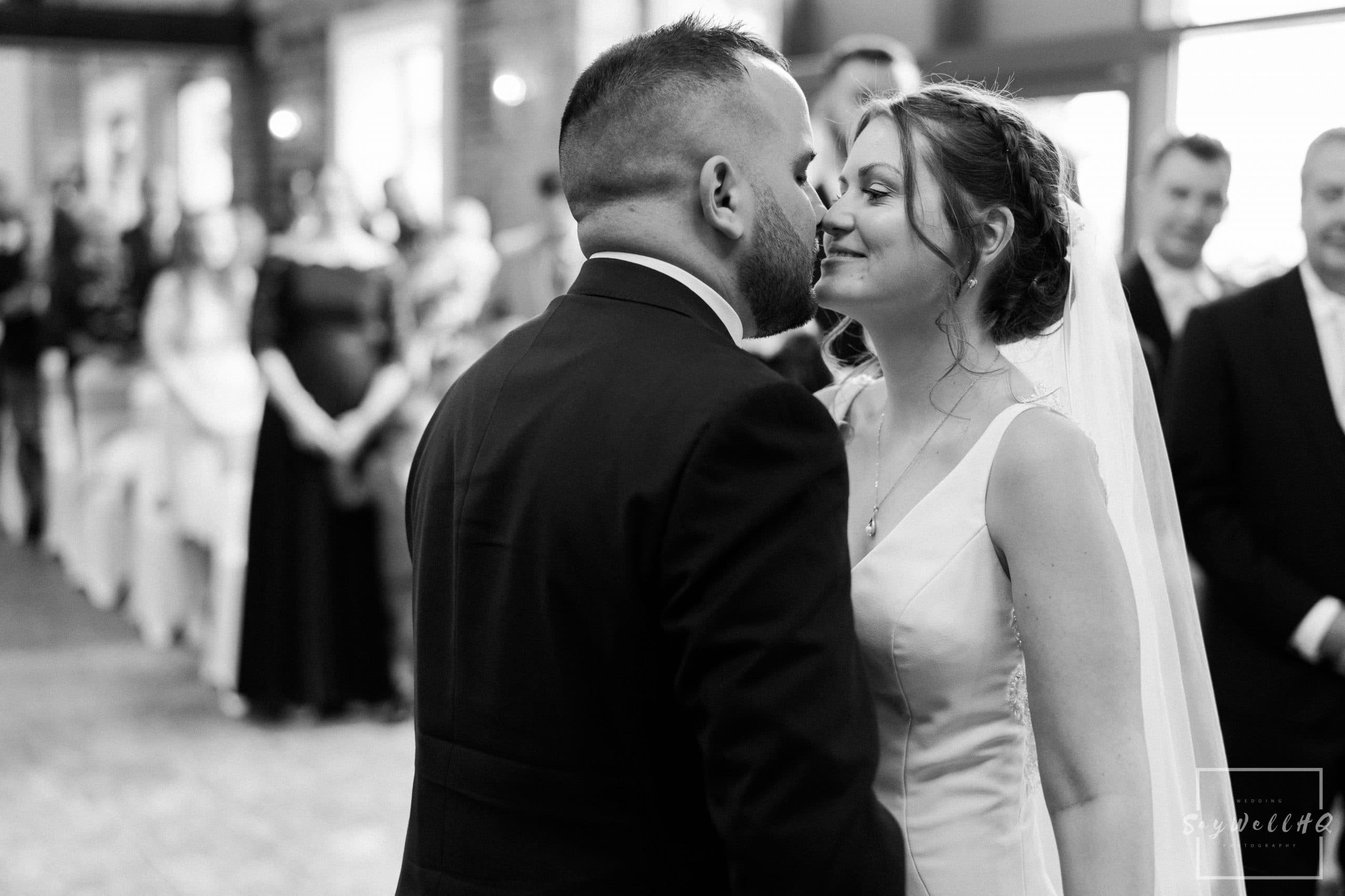 Bride and groom kiss each other during their wedding ceremony at Goosedale - Wedding Photography by goosedale wedding photographer Andy Saywell of SaywellHQ