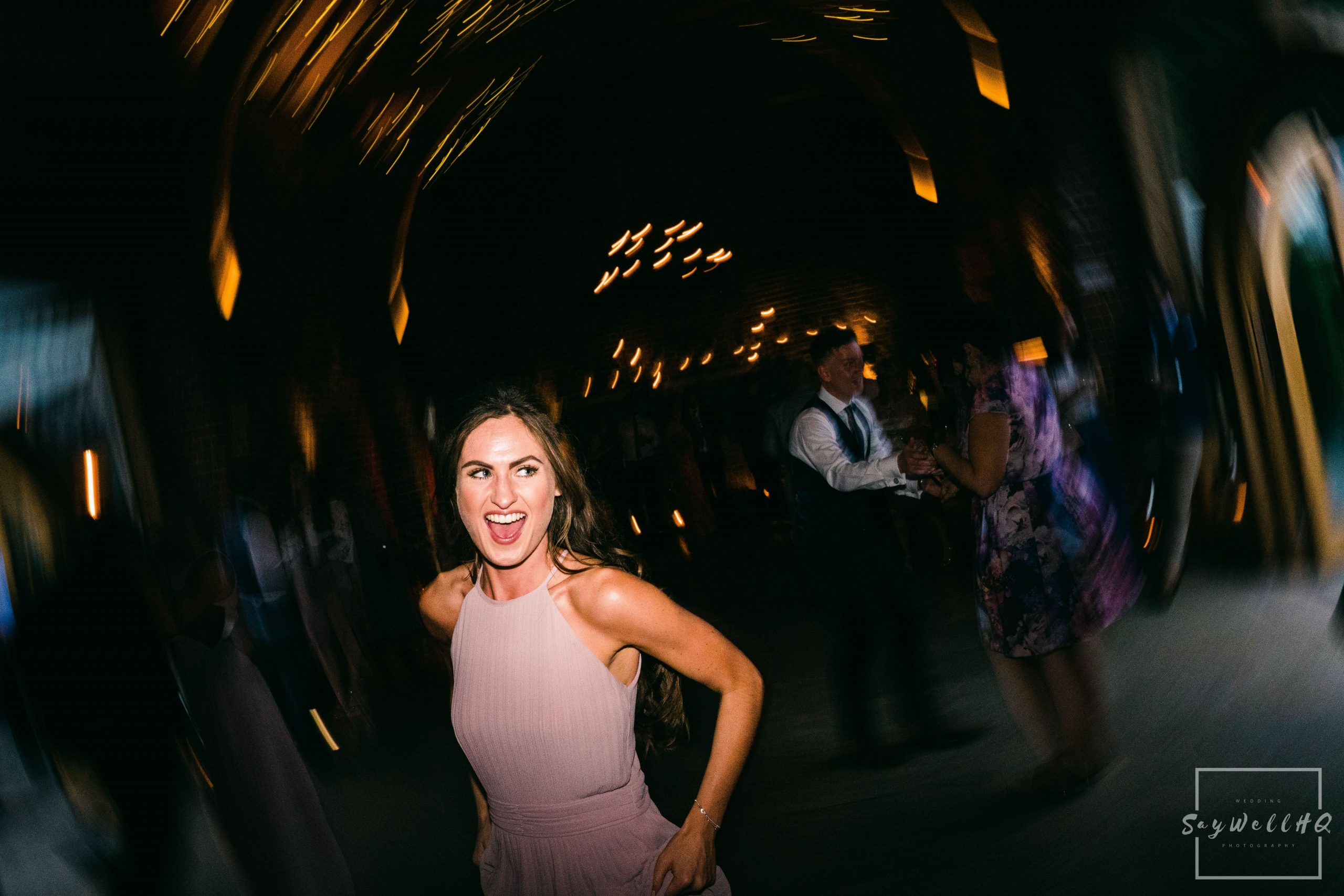 Derby Wedding Photographer - bridesmaid having a laugh during the live band playing at a wedding disco