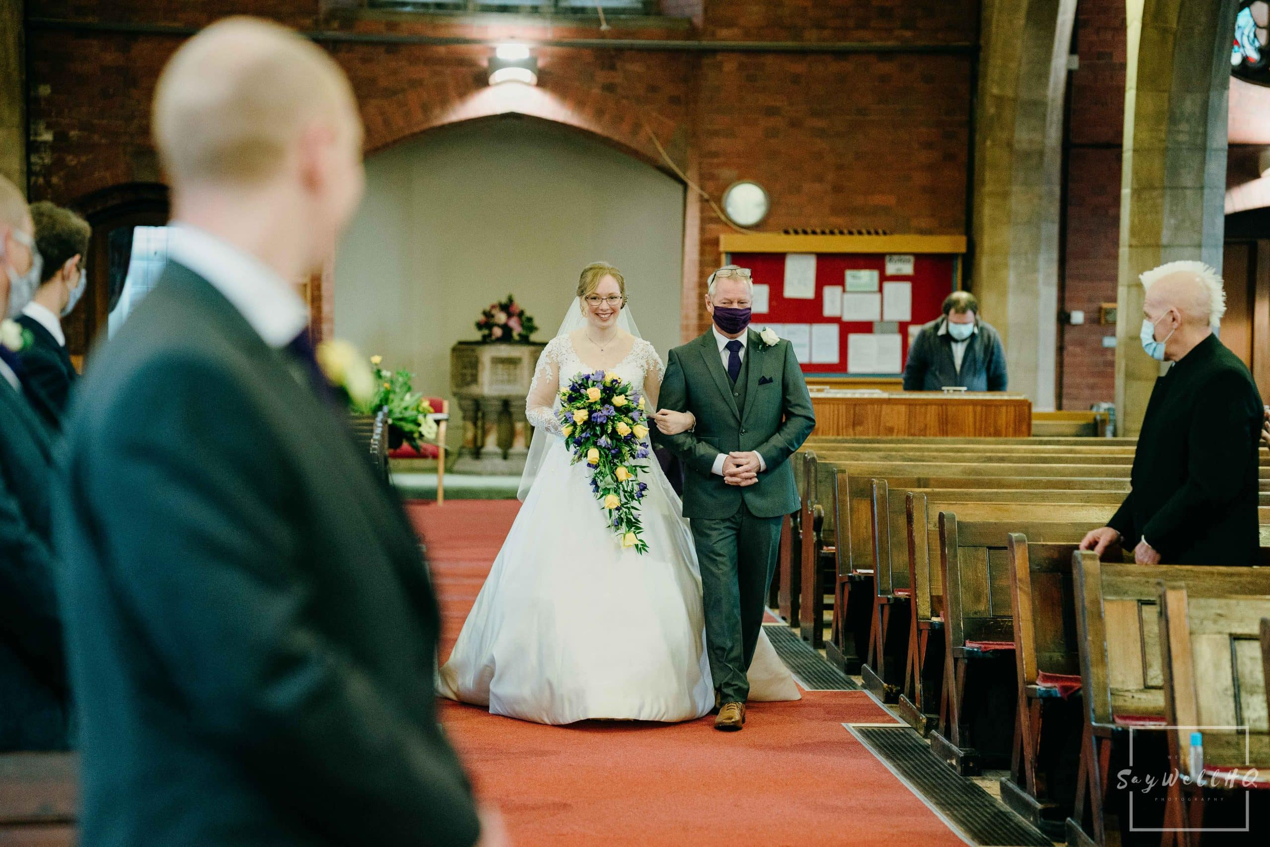Covid Wedding Photography - bride and her dad walk down the aisle - wedding photography by Andy Saywell of SaywellHQ