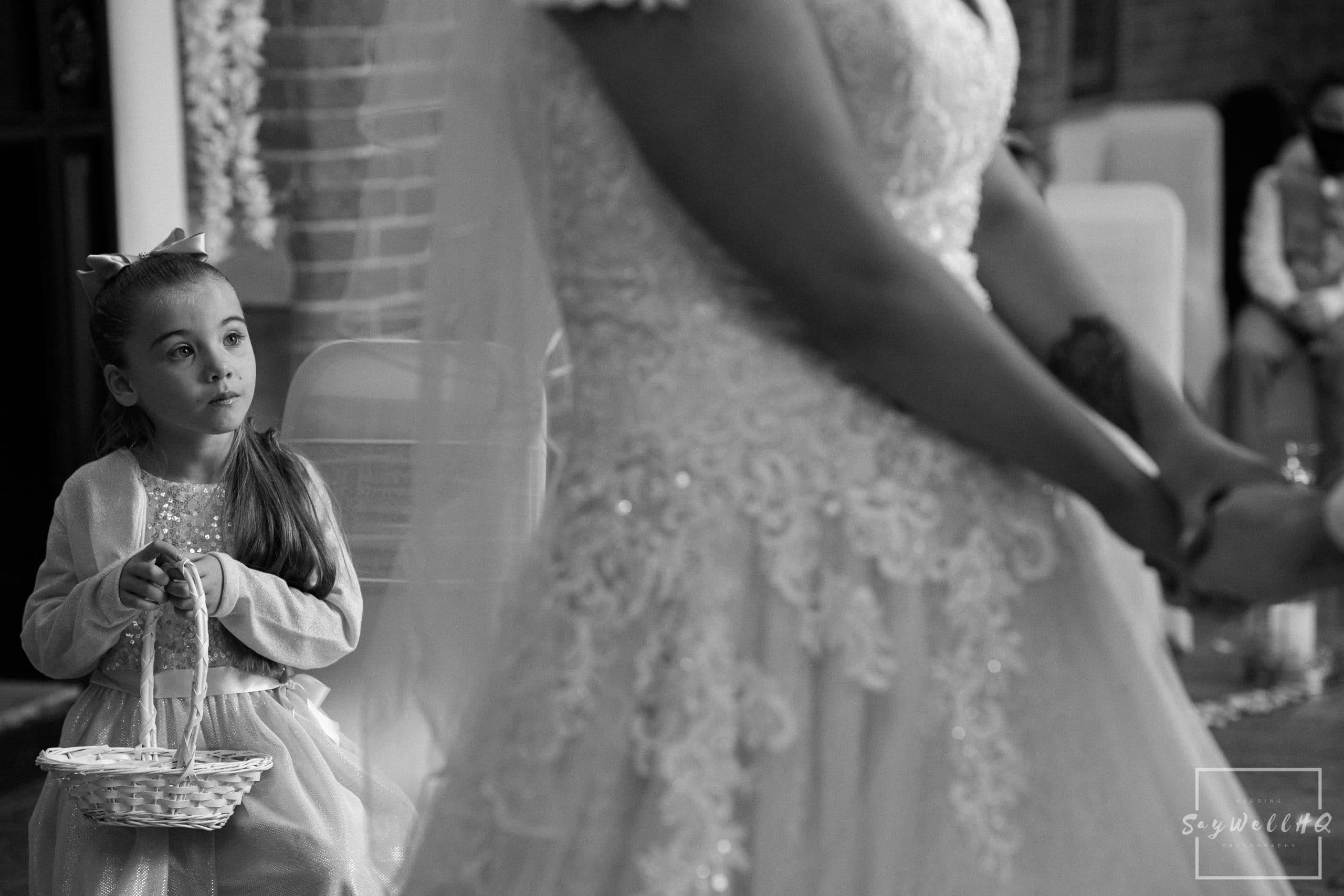 Daughter of the bride looks on at her mum getting married at a Goosedale wedding - Wedding Photography by goosedale wedding photographer Andy Saywell of SaywellHQ