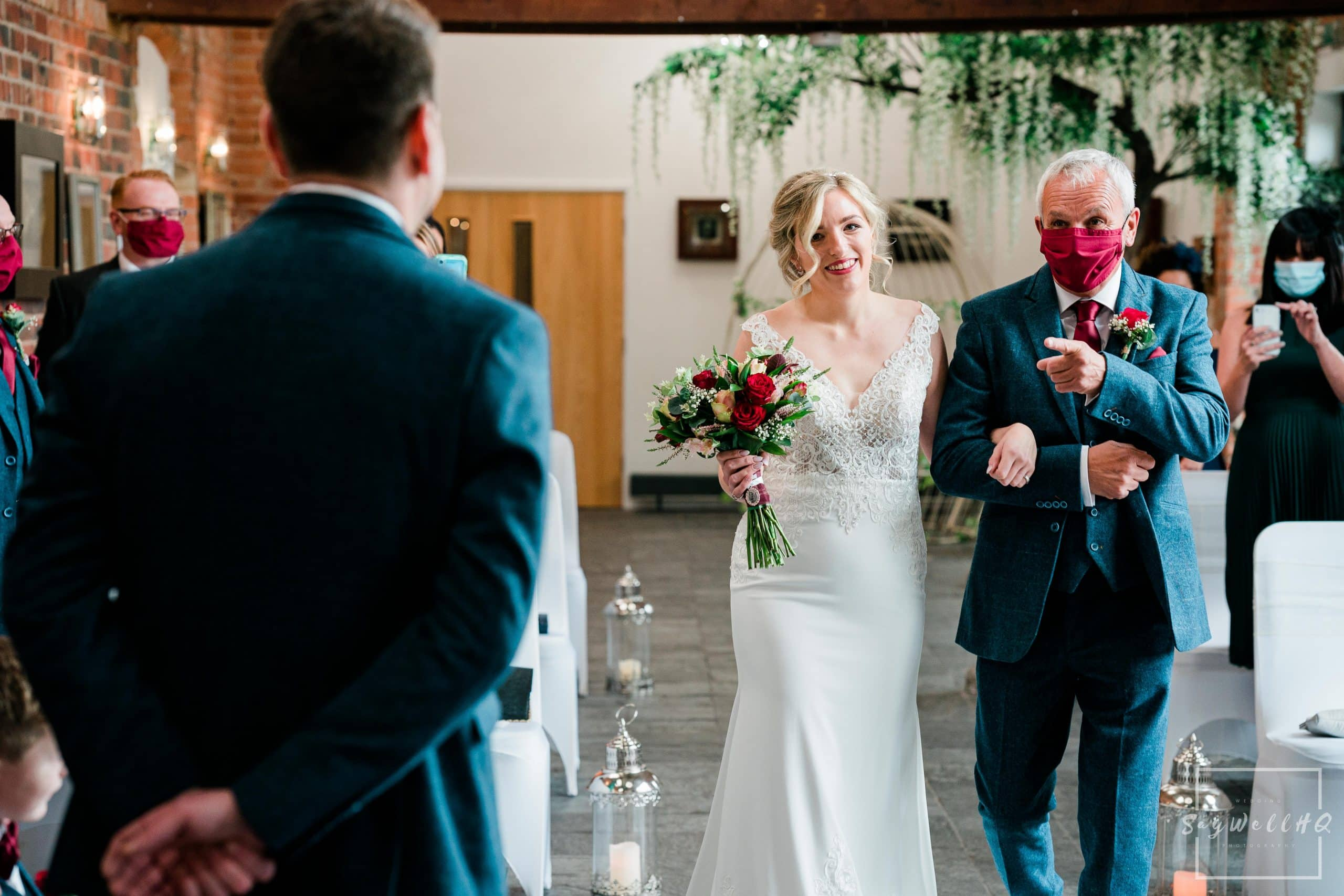 Bride and father of the bride walk down the aisle at macro covid wedding at Goosedale - Wedding Photography by goosedale wedding photographer Andy Saywell of SaywellHQ