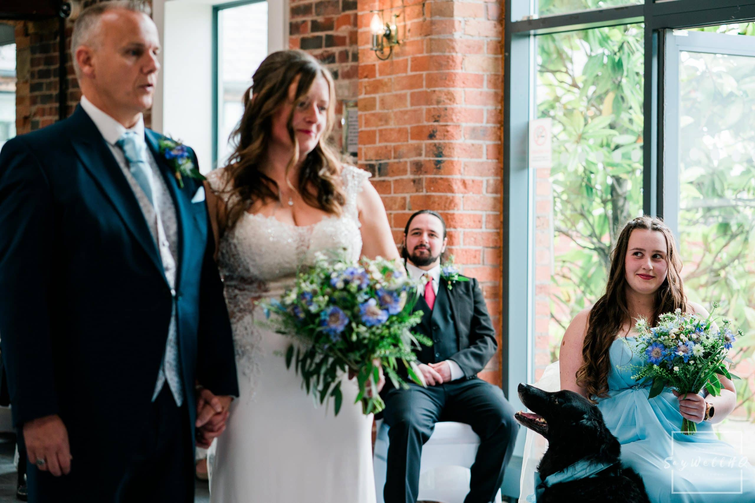 Daughter of the bride looks on at her mum getting married at a Goosedale wedding during the covid 19 restrictions - Wedding Photography by goosedale wedding photographer Andy Saywell of SaywellHQ