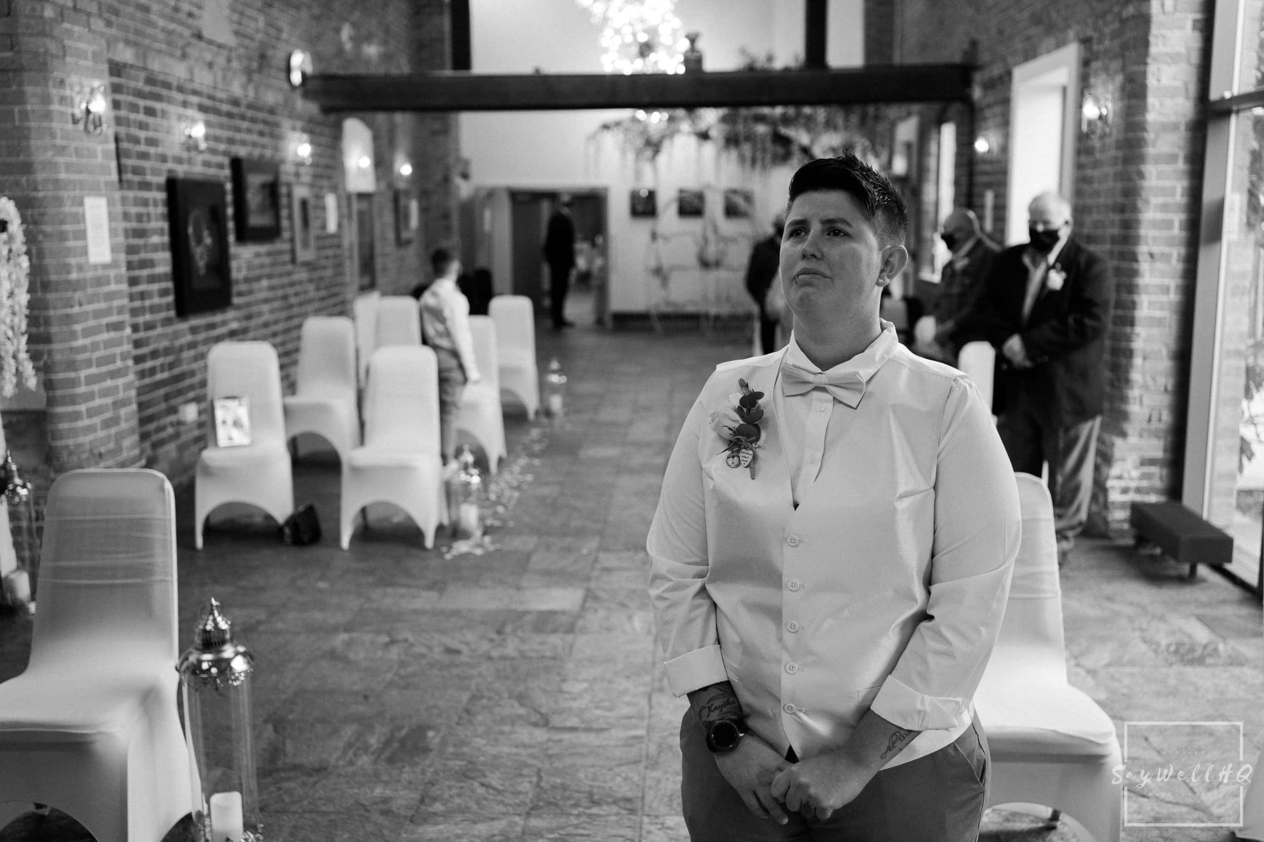 Covid Wedding Photography - emotional partner tearing up before her covid restricted wedding - wedding photography by Andy Saywell of SaywellHQ