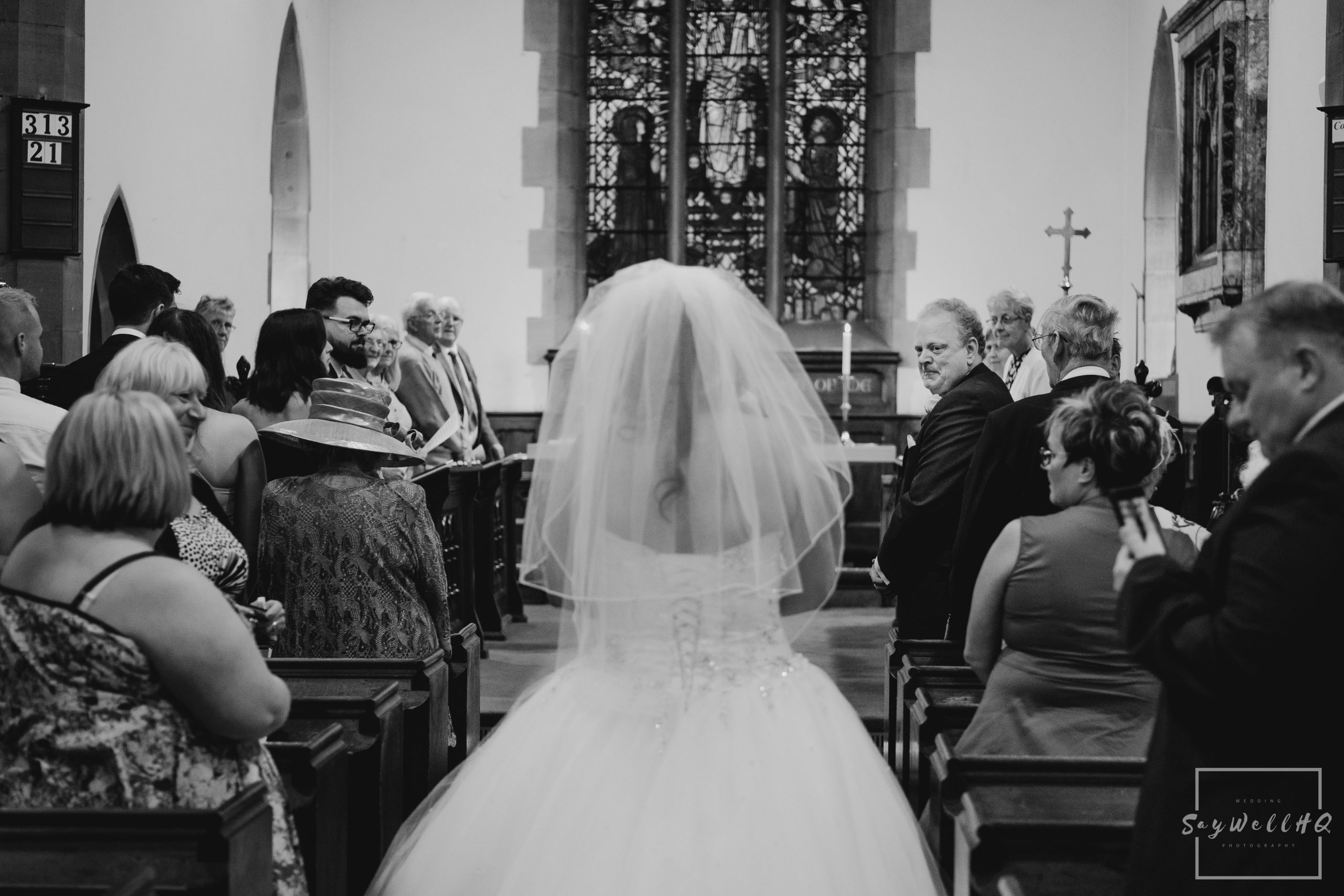 Derby Wedding Photographer - Groom looking at his bride coming down the church aisle