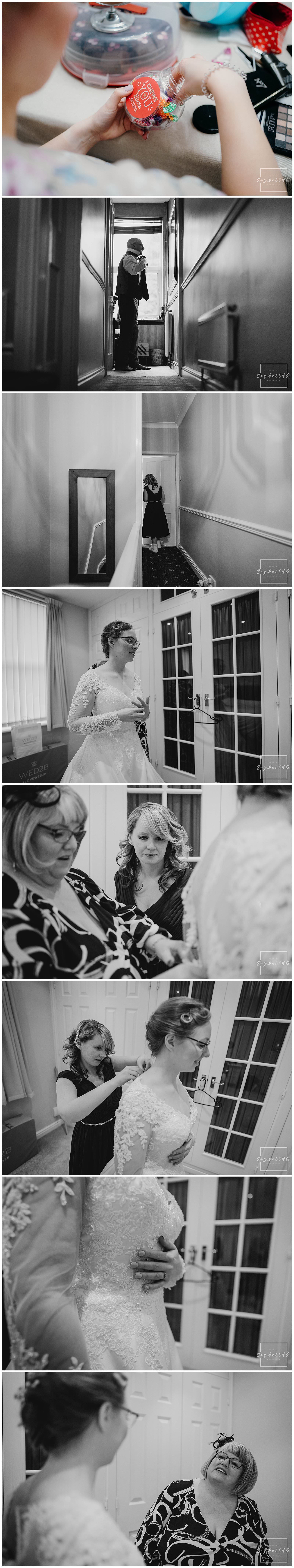 Bride putting on her wedding dress with the help from her mum before her Covid restricted wedding at St Judes Church in Mapperley Nottingham