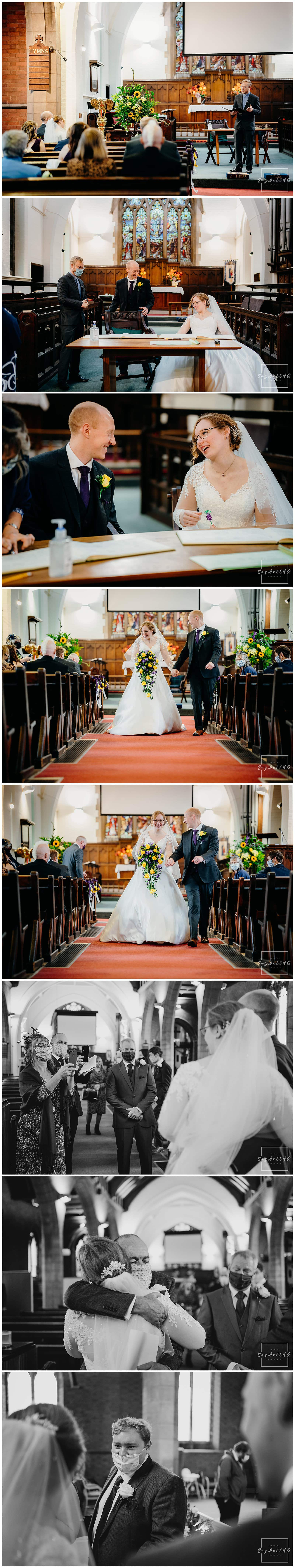 Bride and groom sign the wedding register during the micro wedding at St Judes Church in Mapperley Nottingham