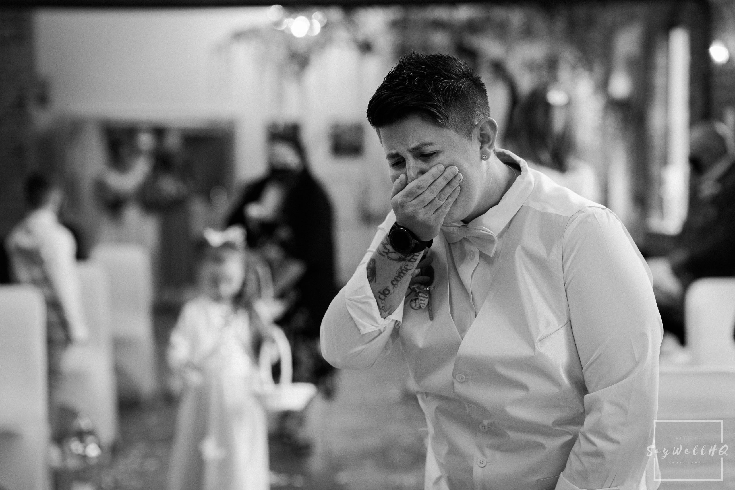 Partner of the bride getting emotional at the sight of her bride walking down the aisle at a covid restricted wedding