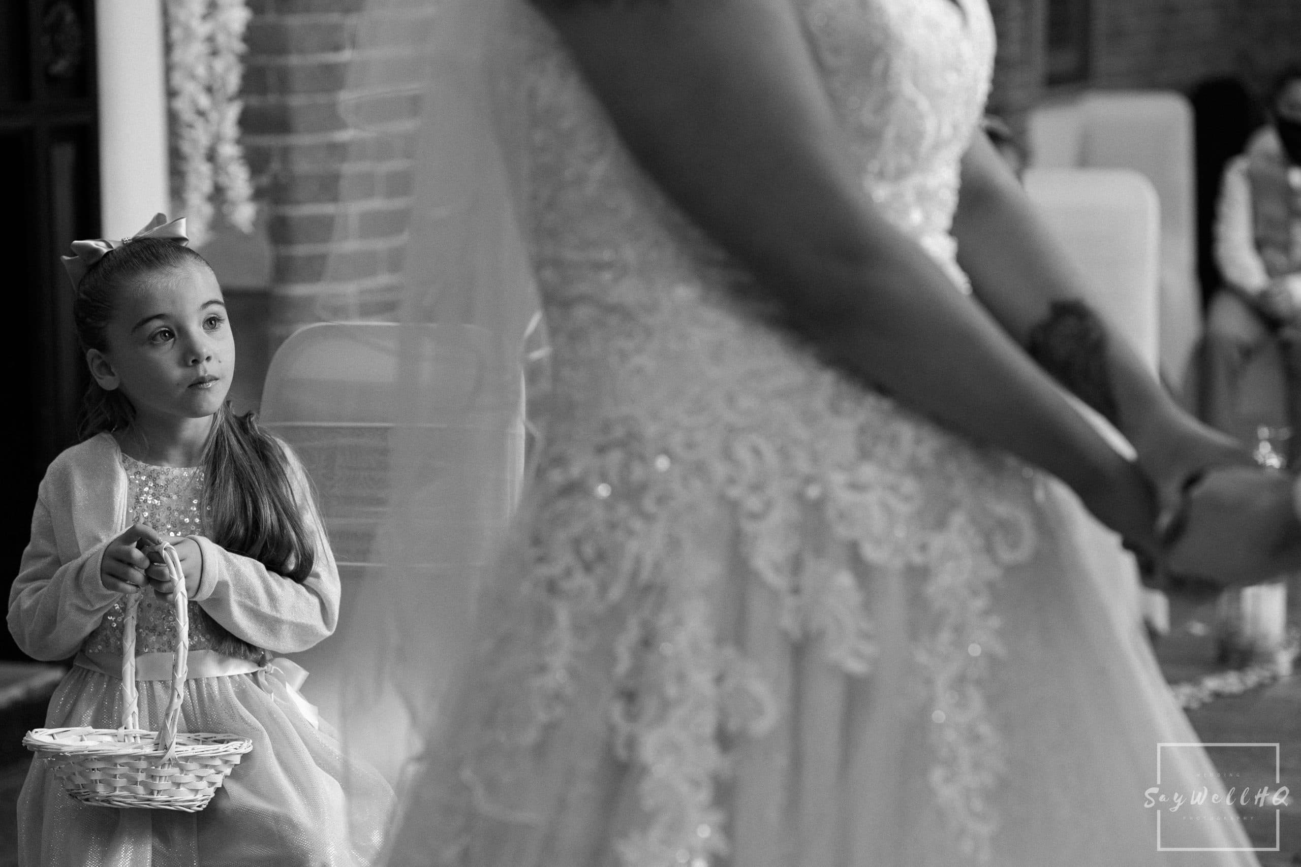 Daughter of the bride looking on at her mum getting married during a covid 19 restricted wedding