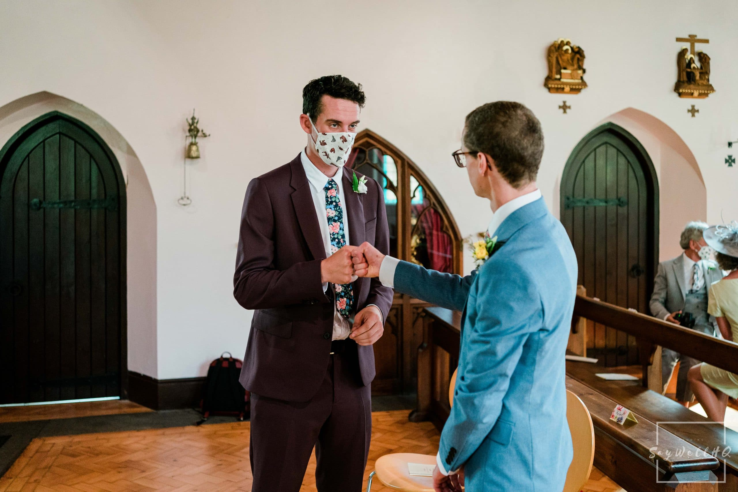 Groom and best man fist bump before the wedding ceremony