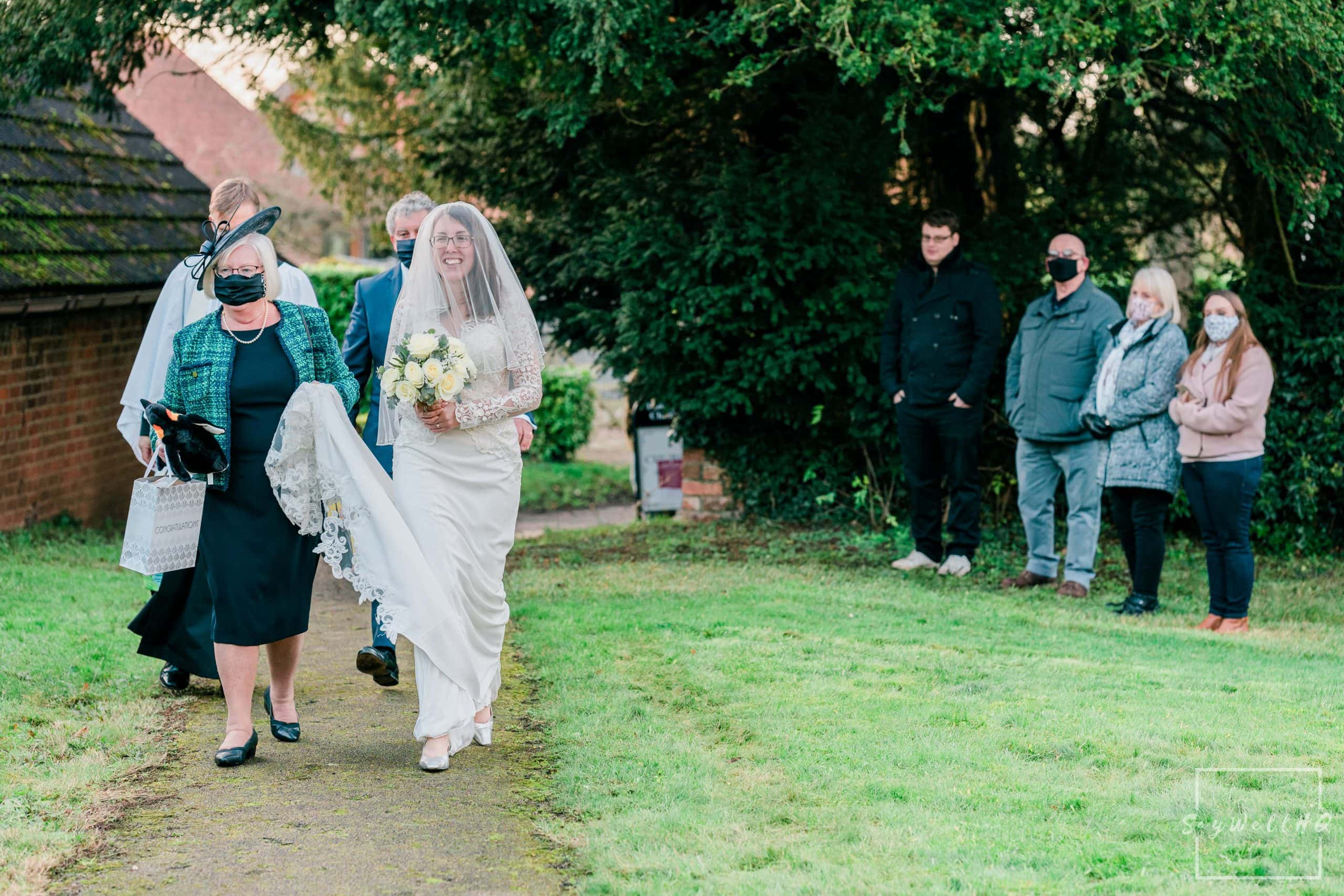 Bride arriving for her wedding at St. Helena Church in Thoroton - Vale of Belvoir wedding photography