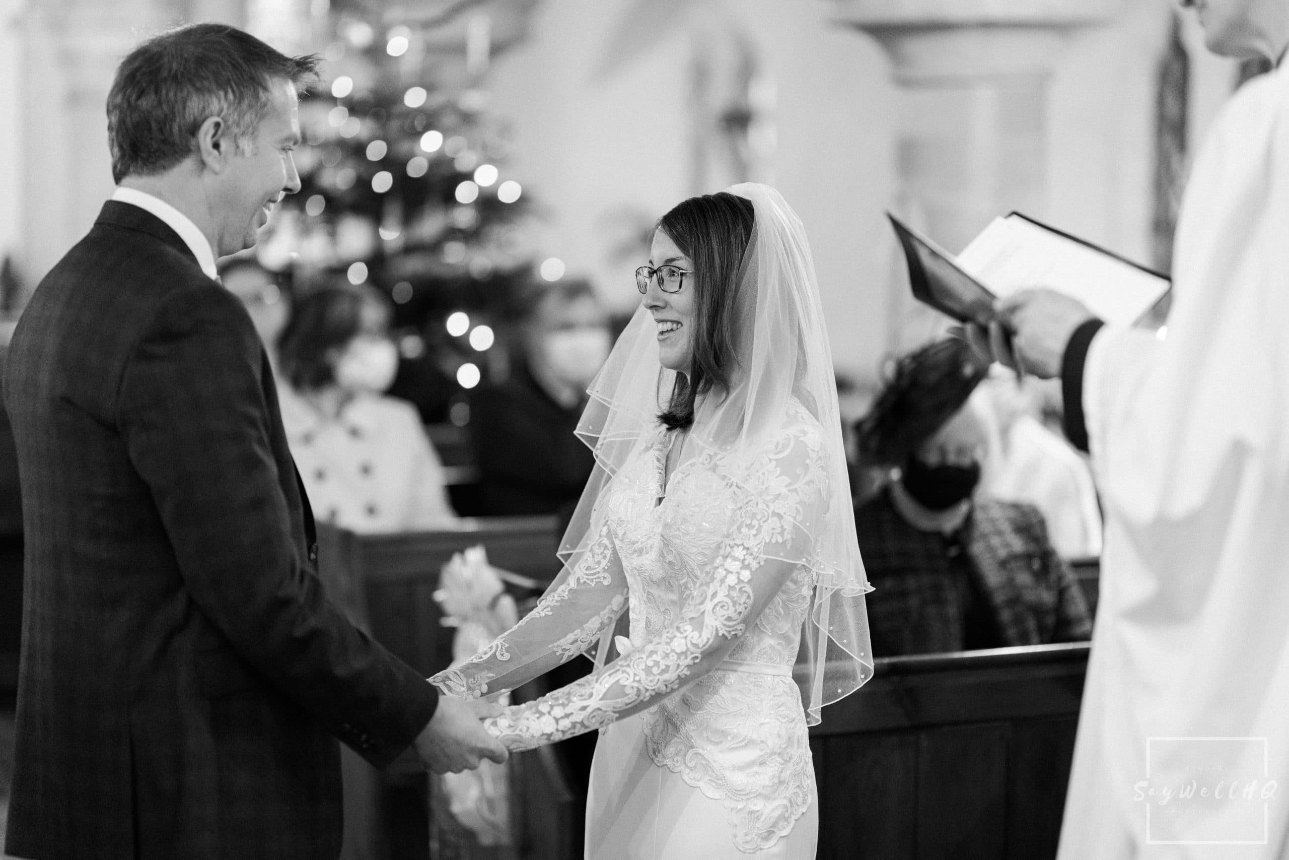 Bride and Groom exchange vows at their wedding at St. Helena Church in Thoroton - Vale of Belvoir wedding photography