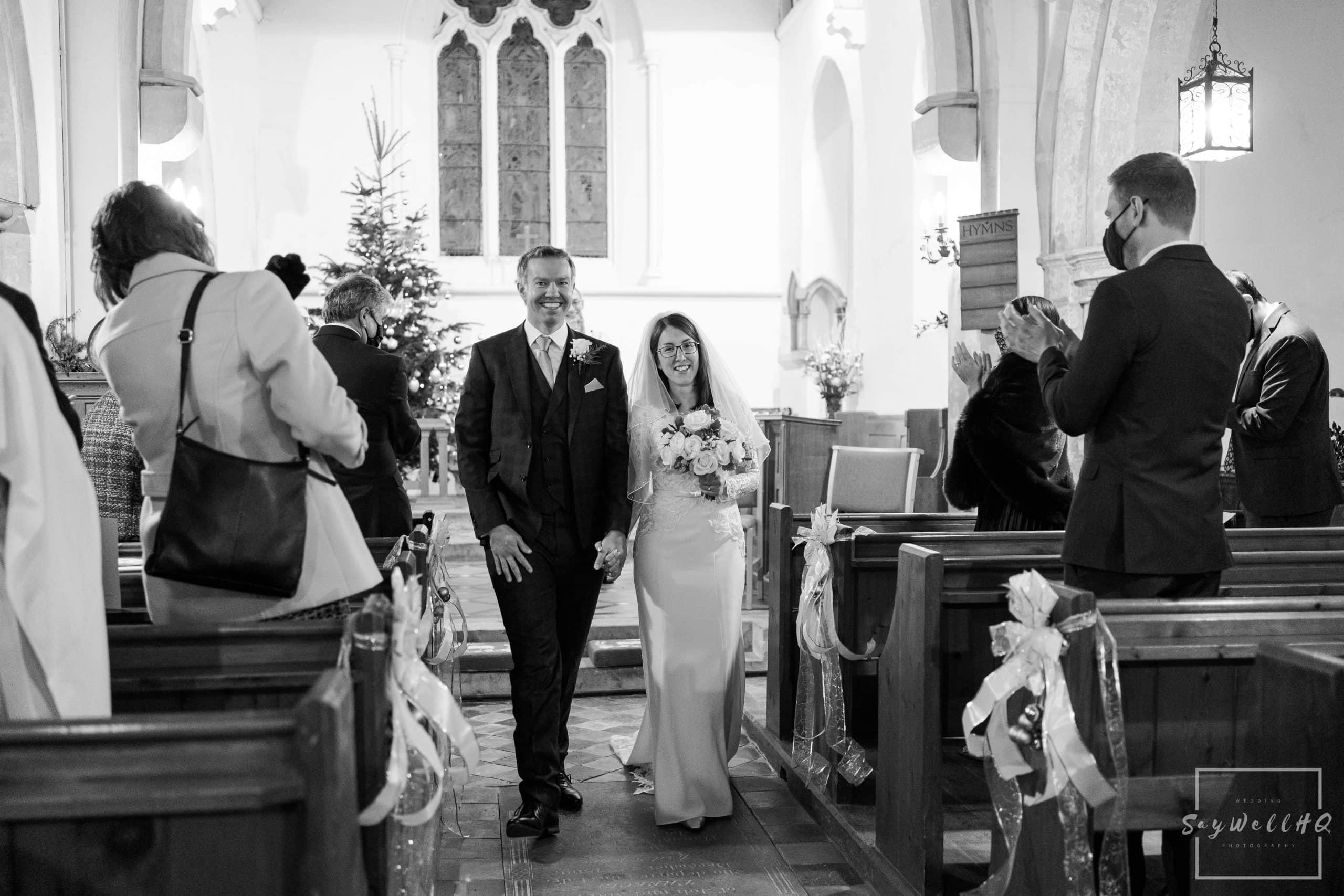 Bride and Groom walking back down the Aisle as husband and wife at St. Helena Church in Thoroton - Vale of Belvoir wedding photography