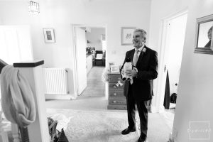 Dad seeing is daughter in her wedding dress on the day of her wedding - Vale of Belvoir wedding photography