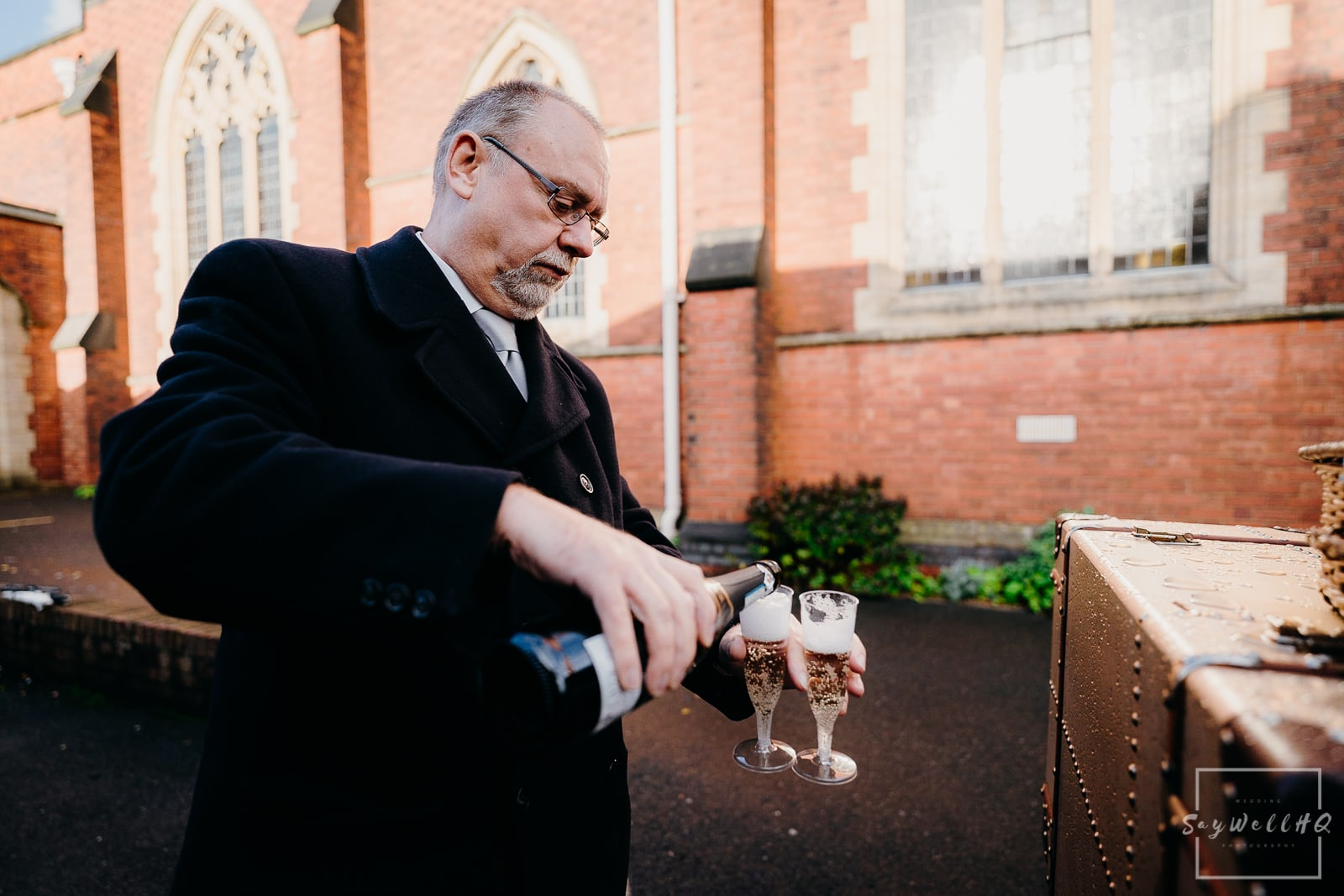 St Judes Church Mapperley Wedding Photography - Bride and Groom enjoy a quick drink of bubbly following their wedding ceremony at St Judes Chuch in Mapperley