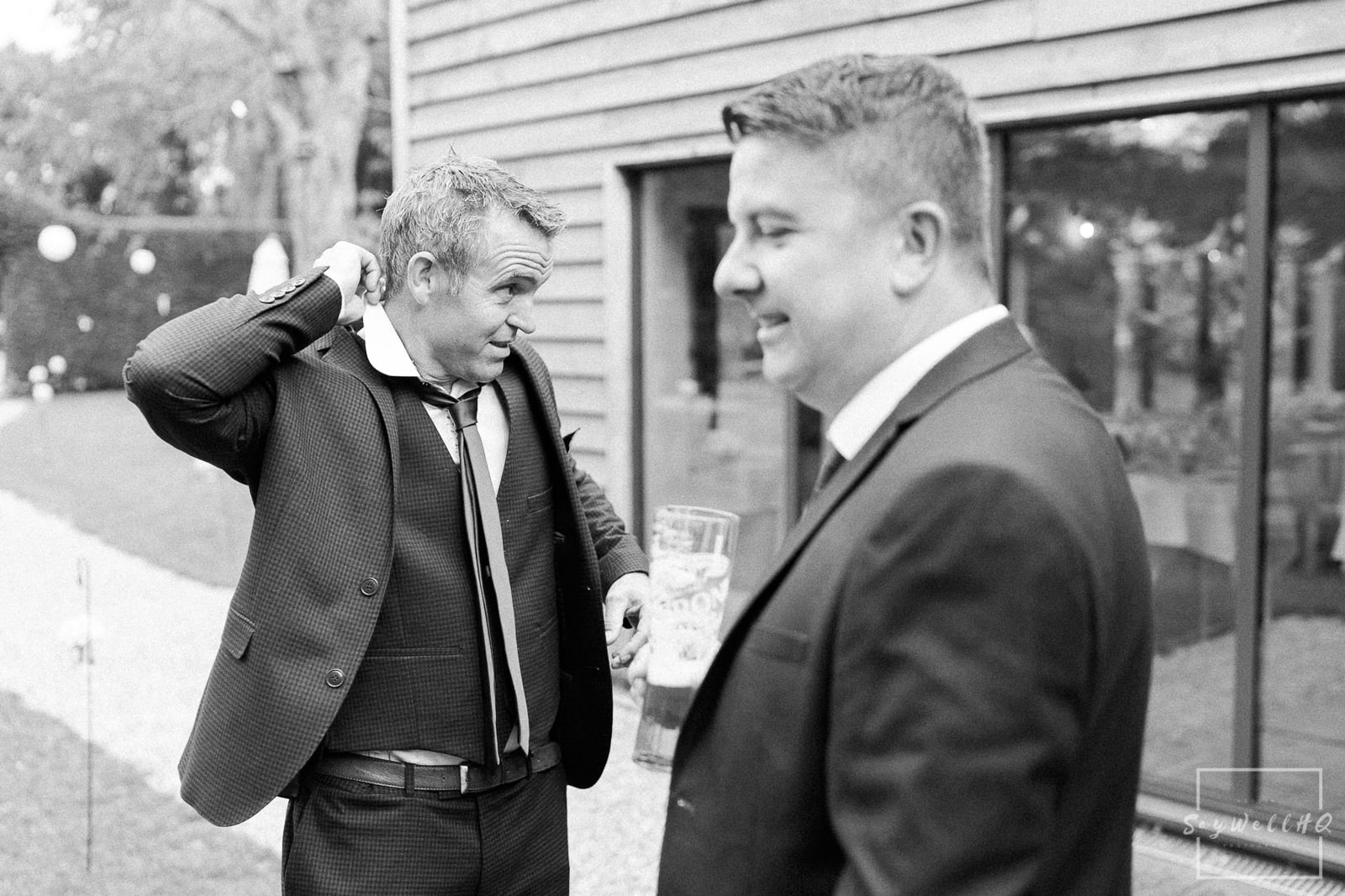 The Chequers Inn Wedding Photography - wedding guests arrive for the wedding