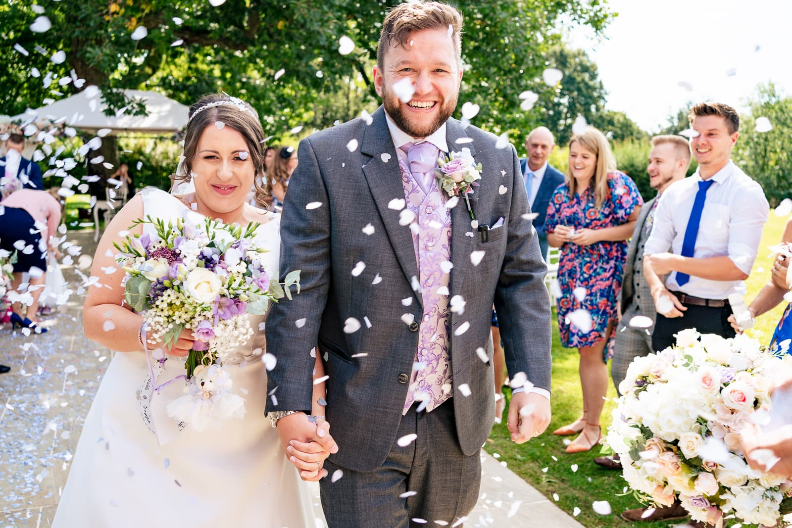 Leicester Wedding Photography at Winstanley House - Winstanley House Wedding Photography - Bride and groom get covered in confetti after their outdoor wedding ceremony