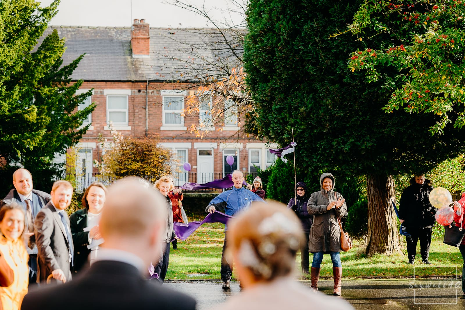 St Judes Church Mapperley Wedding Photography - wedding guests greet the newly weds outside the Church following the wedding ceremony