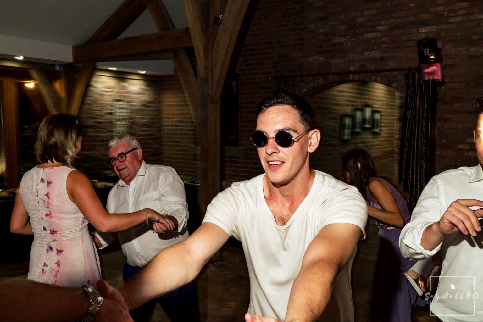 Swancar Farm Wedding Photography - wedding guests enjoy the wedding disco at Swancar Farm in Nottingham