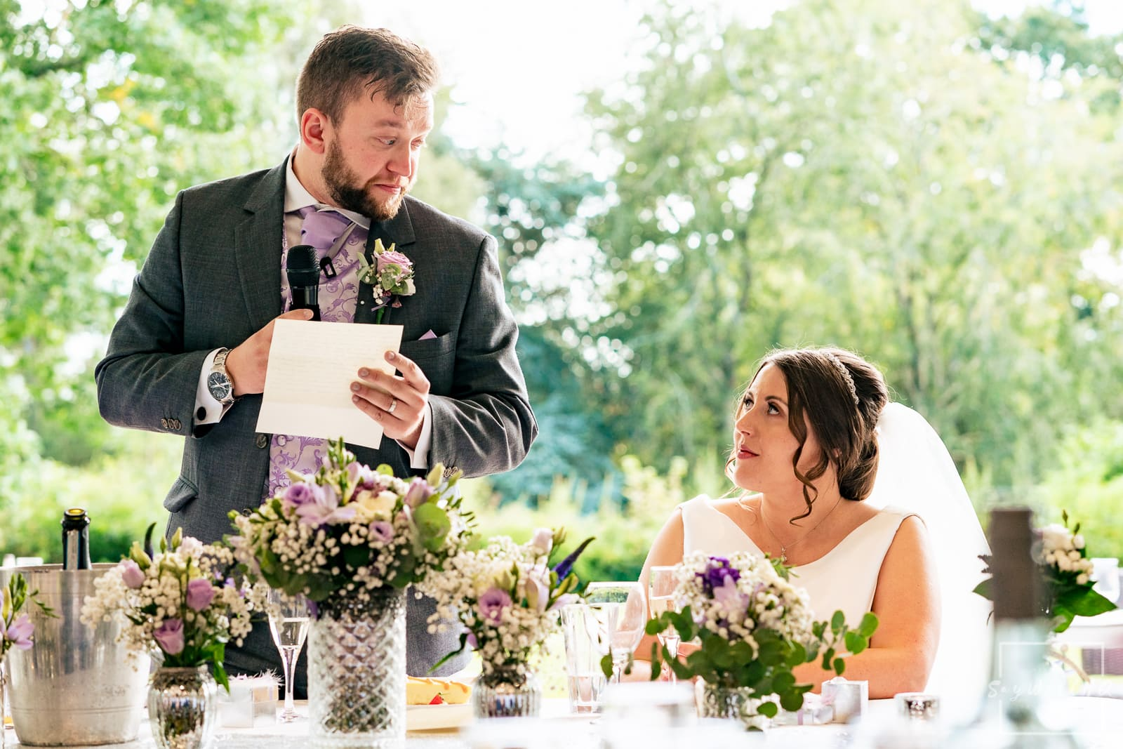 Winstanley House Wedding Photography - Groom reads his speech to his emotional bride