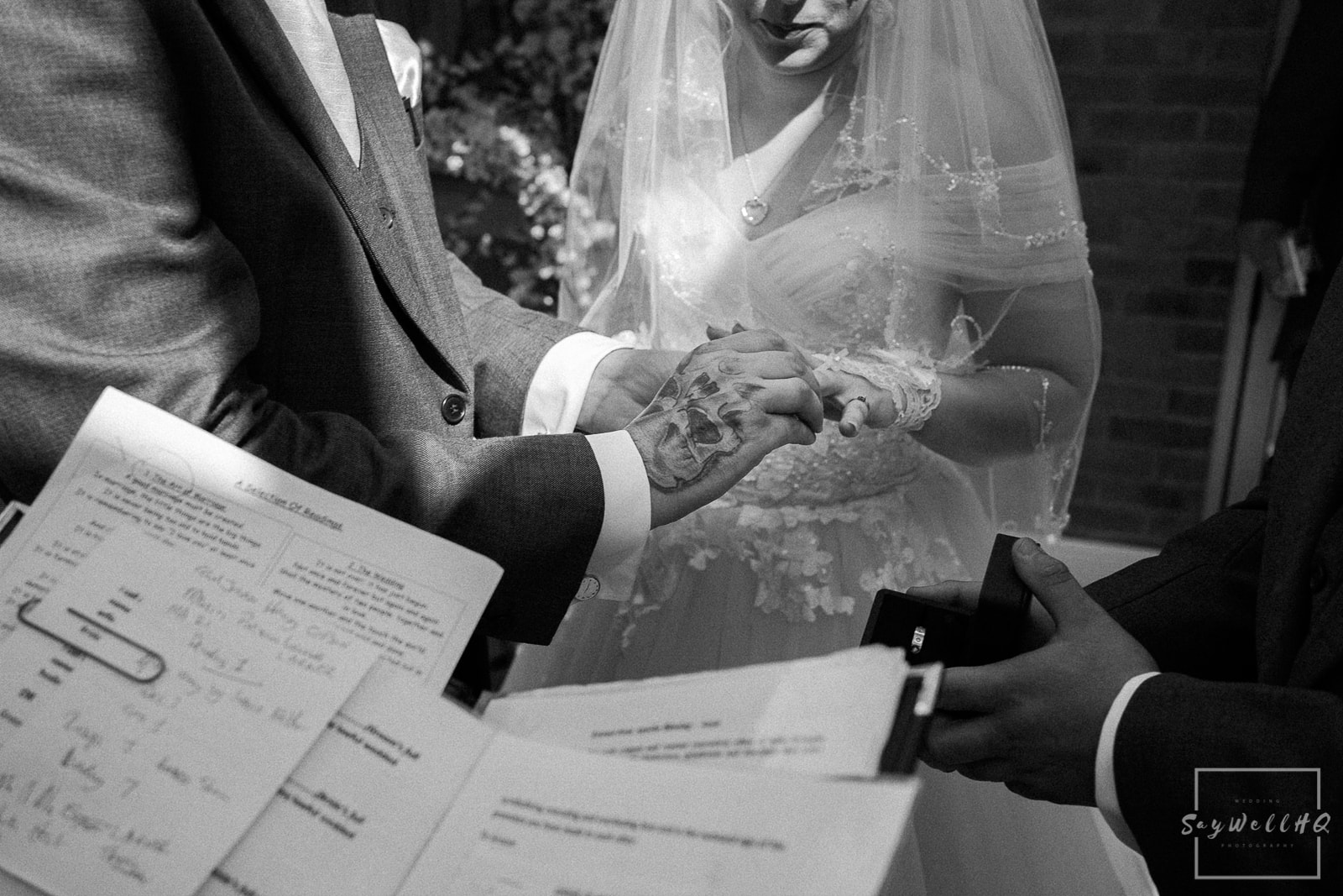 White Hart Inn Wedding Photography - Bride and Groom exchange rings at their wedding