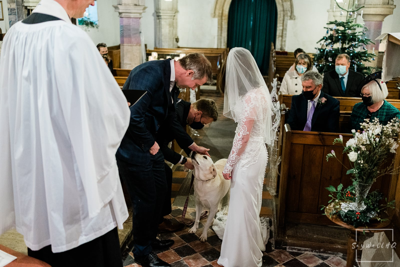 Vale of Belvoir Wedding Photography - dog ring bearer delivering the wedding rings to the bride and groom
